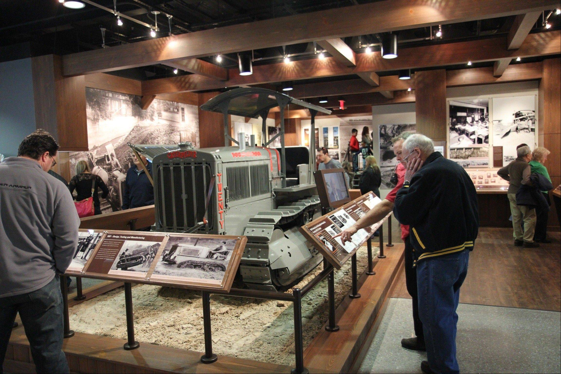 People tour the Caterpillar Visitors Center in Peoria. The center lets visitors climb inside the machines for a closer look while computer simulations provide an opportunity to learn how to manipulate the controls.