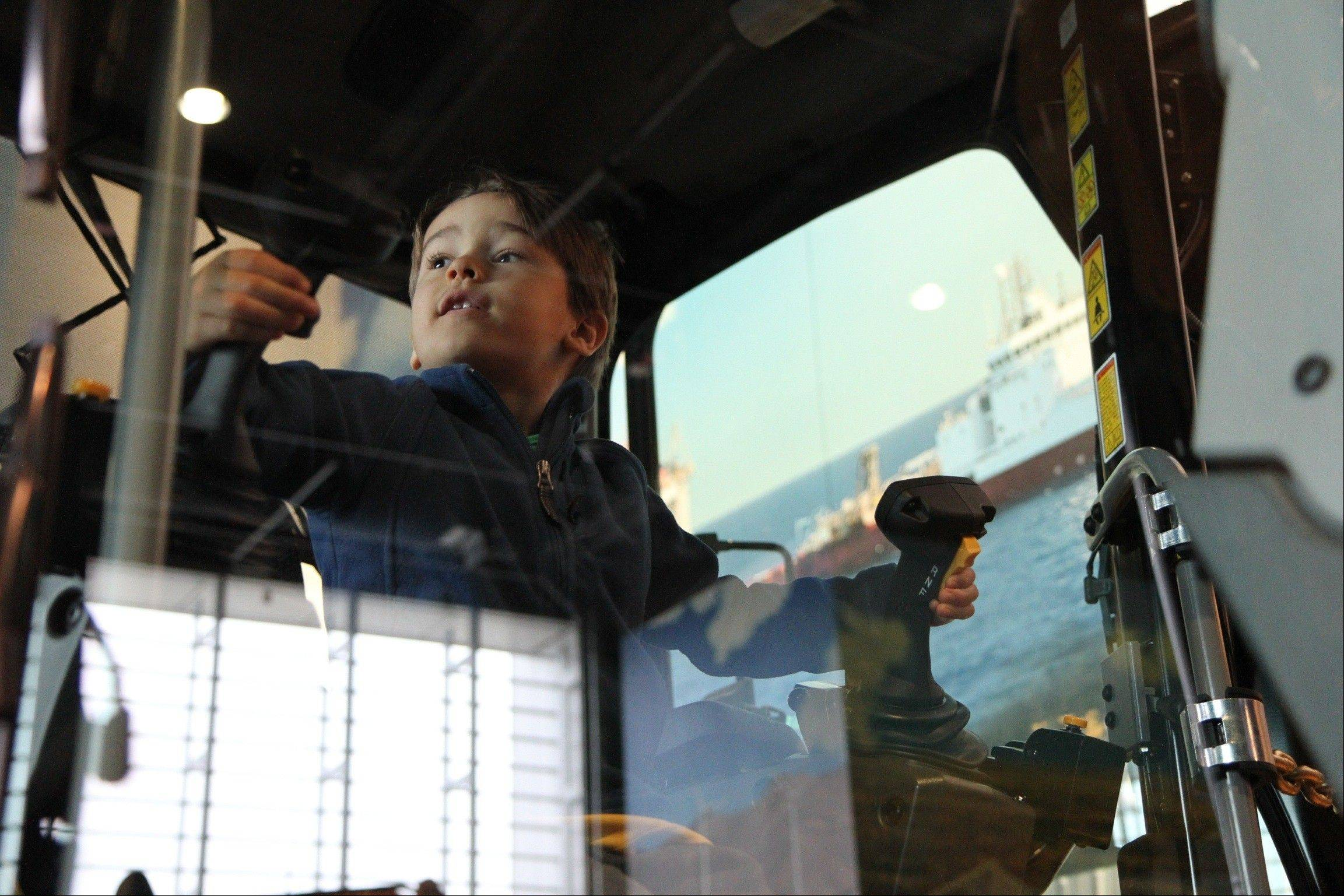 A boy tests equipment at the Caterpillar Visitors Center in Peoria.