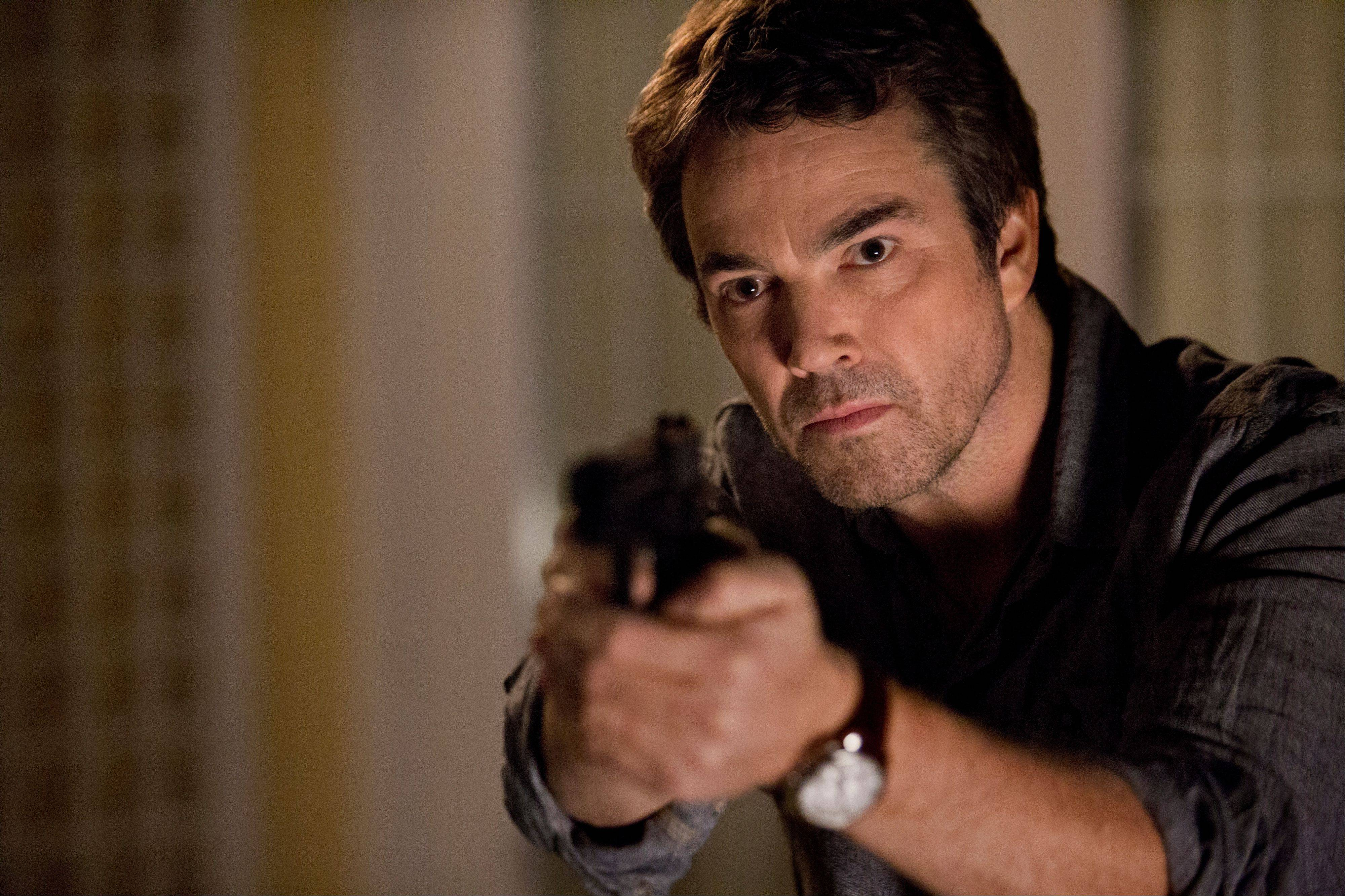 "Former Secret Service Agent Sean King (Jon Tenney) finds a new career as a private detective in TNT's new crime drama ""King & Maxwell,"" premiering Monday, June 10."