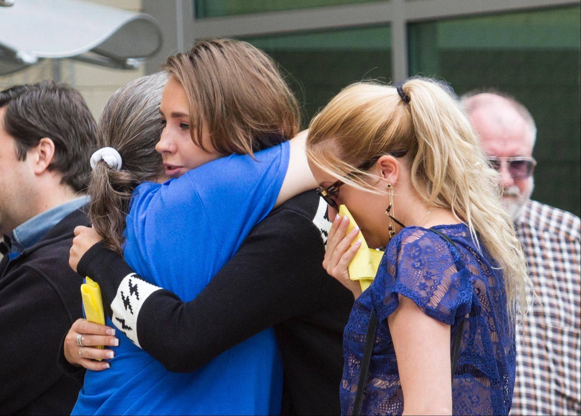 Students and faculty members of Santa Monica College comfort each other Sunday, two days after a shooting spree left six people dead, including the suspected gunman.