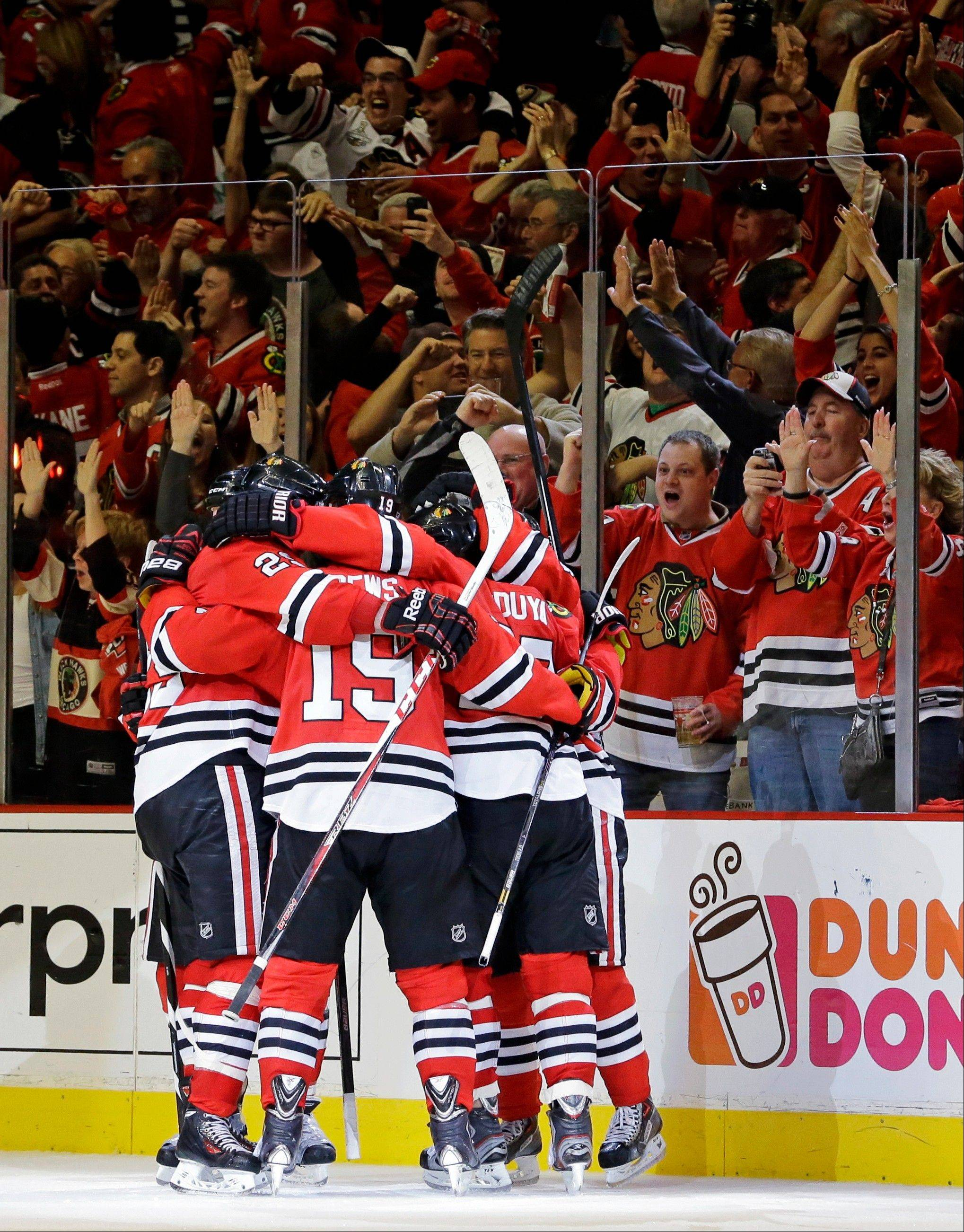 Chicago Blackhawks celebrate after right wing Patrick Kane scored a goal during the third period in Game 5 of the NHL hockey Stanley Cup playoffs Western Conference finals against the Los Angeles Kings, Saturday, June 8, 2013, in Chicago.