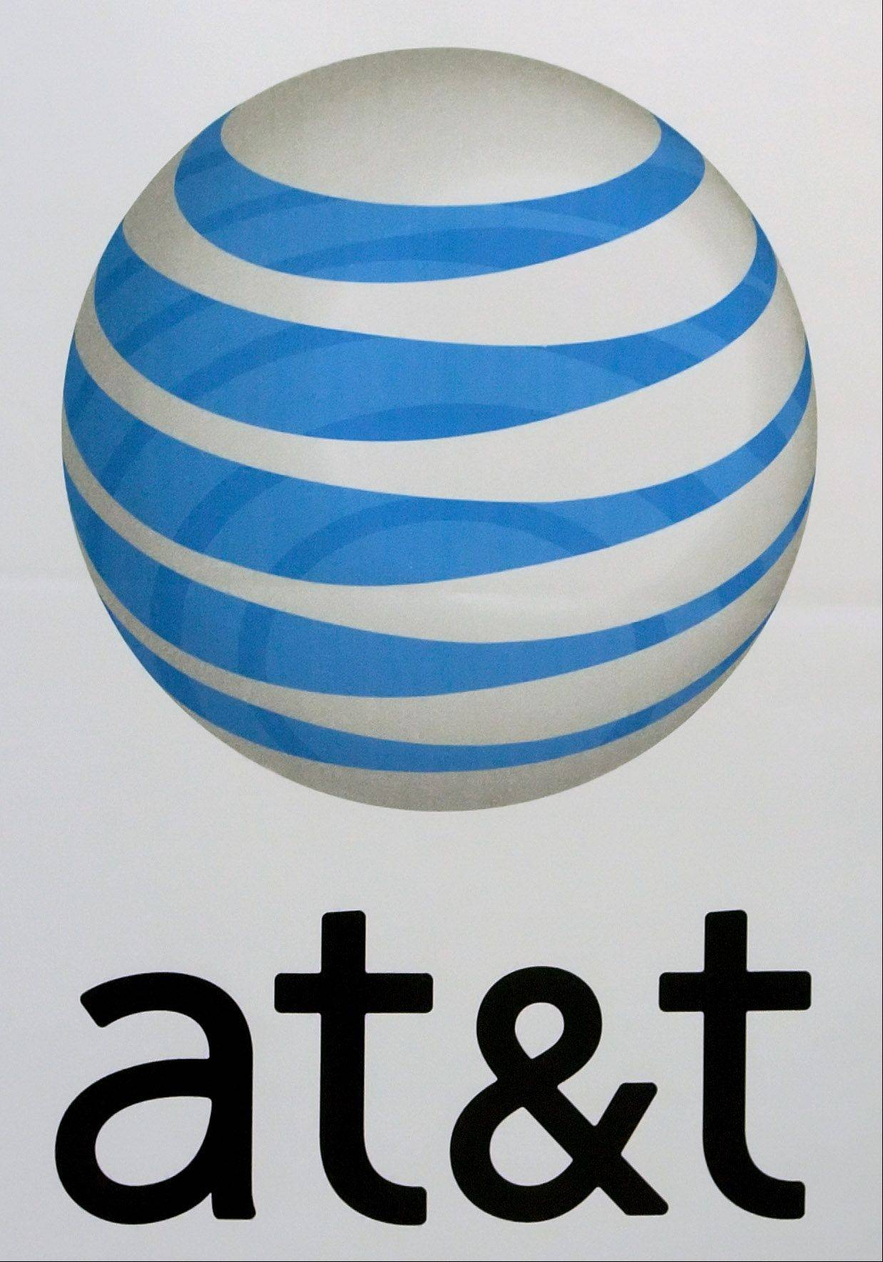 AT&T is adding a walkie-talkie-like application to the iPhone for its corporate customers, replicating a hallmark feature of the Nextel network, which is being shut down this summer.
