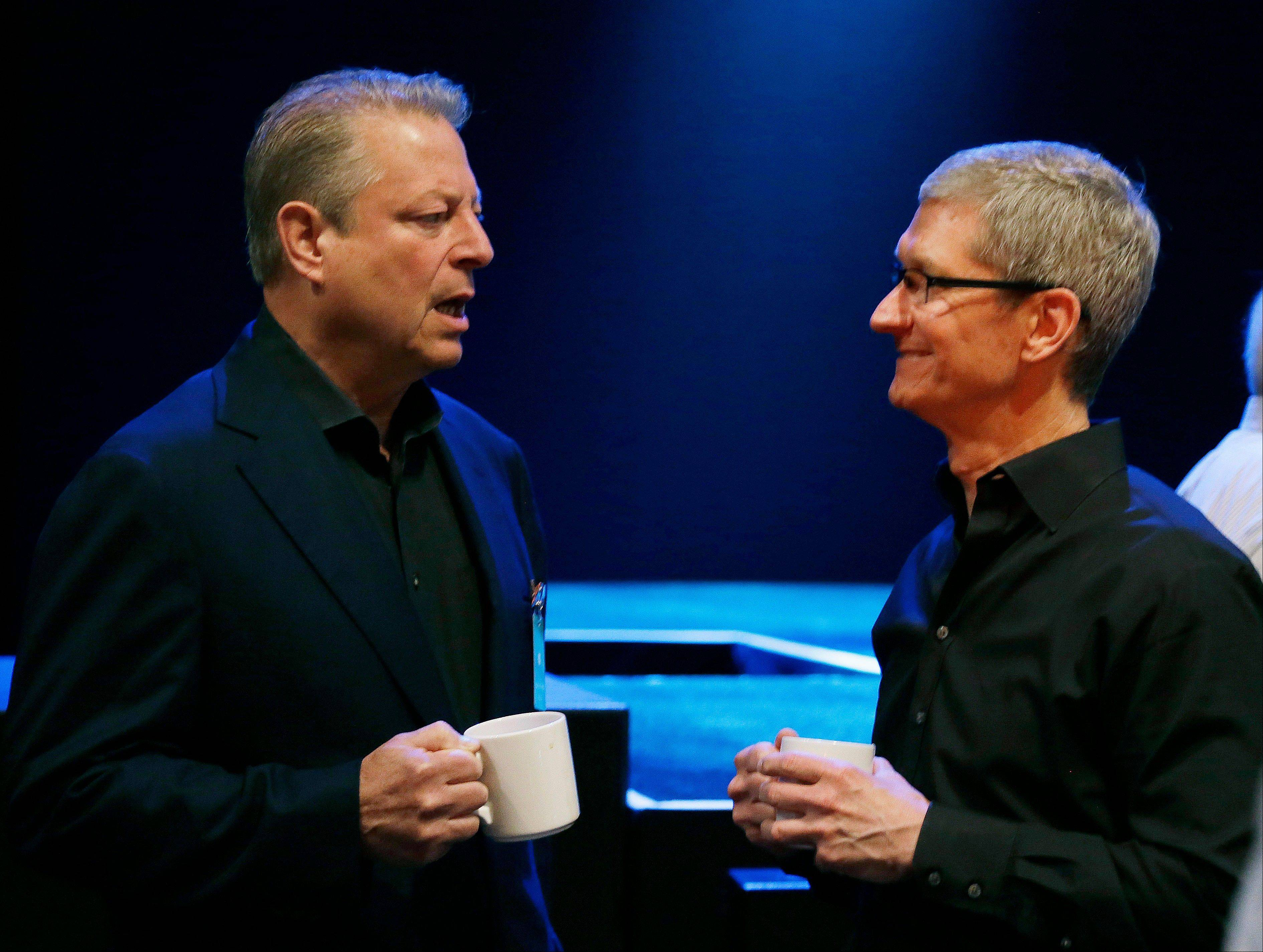 Apple CEO Tim Cook, right, talks with former Vice President Al Gore before giving the keynote address of the Apple Worldwide Developers Conference on Monday in San Francisco.