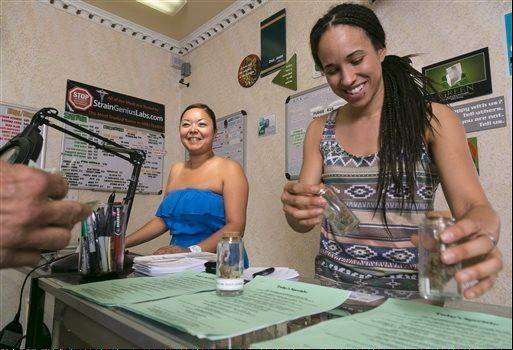 Rosy Solis, left, and Nicole Denis help fill medical marijuana prescriptions at the Venice Beach Care Center medical marijuana dispensary in Venice, Calif.