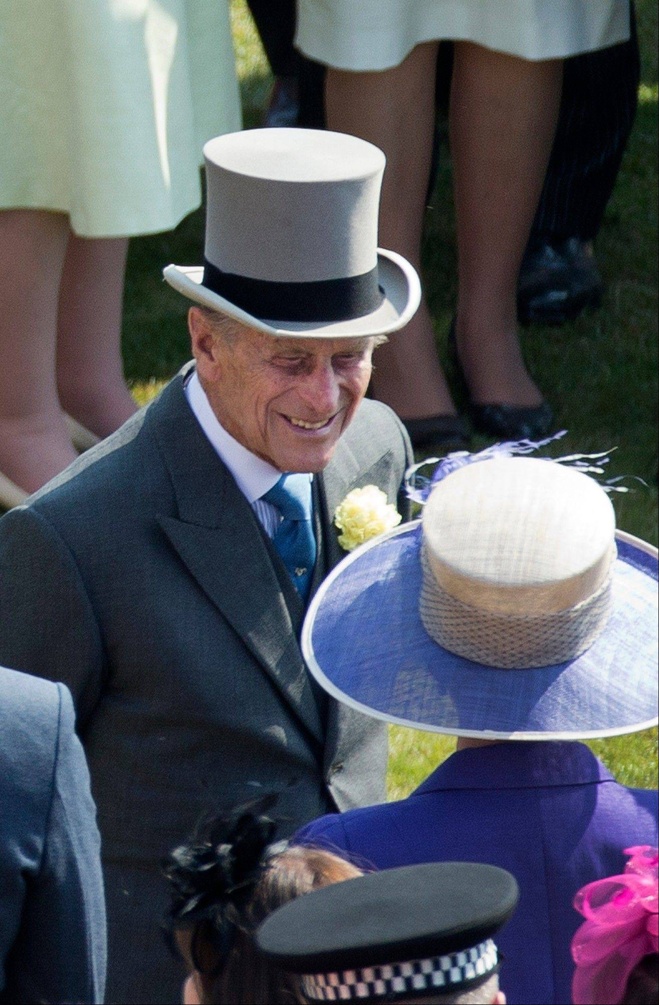 Prince Philip, the husband of Britain�s Queen Elizabeth II attends a garden party at Buckingham Palace in London Thursday. Buckingham Palace says Queen Elizabeth II�s husband was later admitted to a London hospital for an exploratory operation. The palace said the operation on 91-year-old Prince Philip will come after �abdominal investigations,� but did not elaborate.