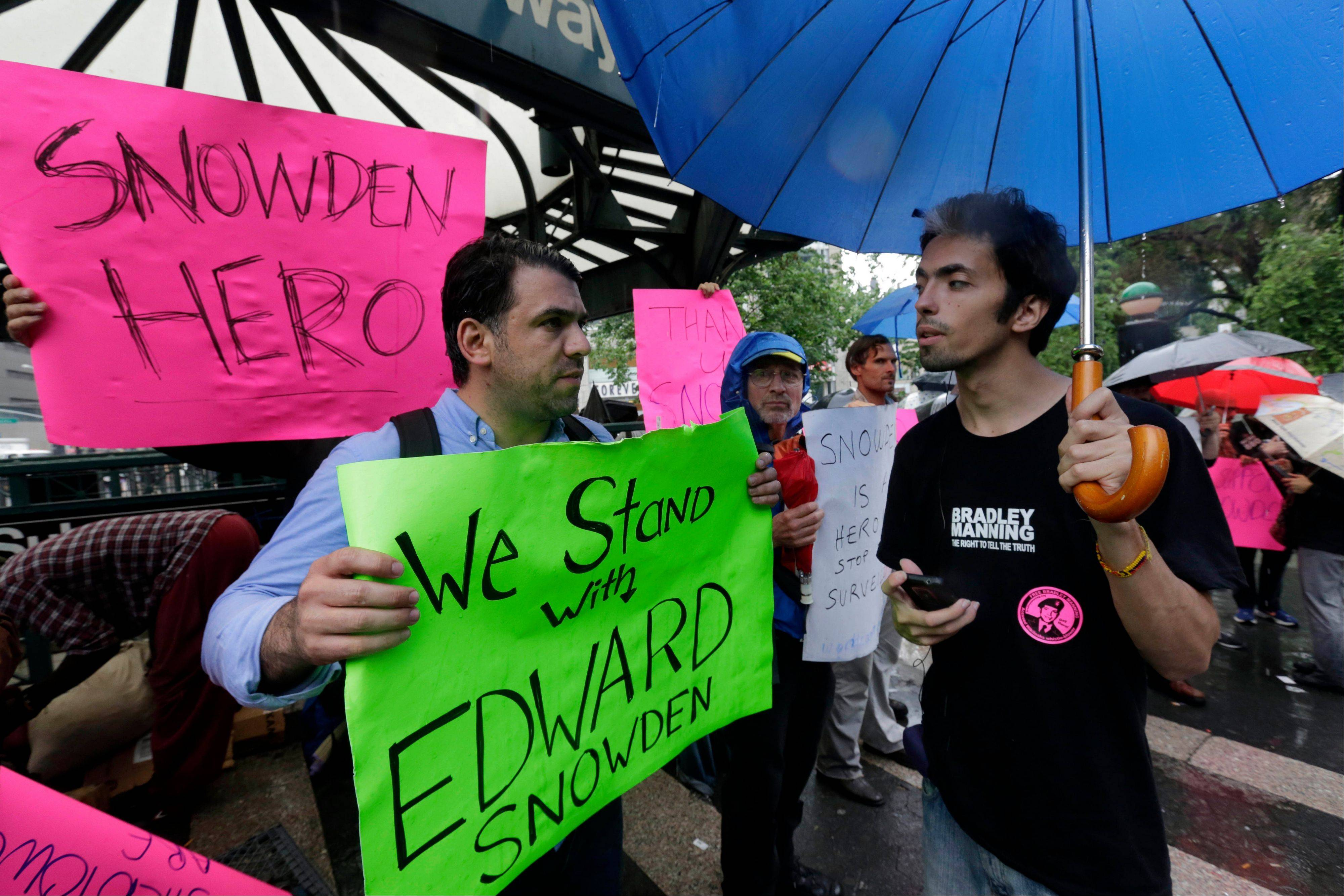 Demonstrators hold signs supporting Edward Snowden in New York�s Union Square Park Monday. Snowden, who says he worked as a contractor at the National Security Agency and the CIA, gave classified documents to reporters, making public two sweeping U.S. surveillance programs and touching off a national debate on privacy versus security.