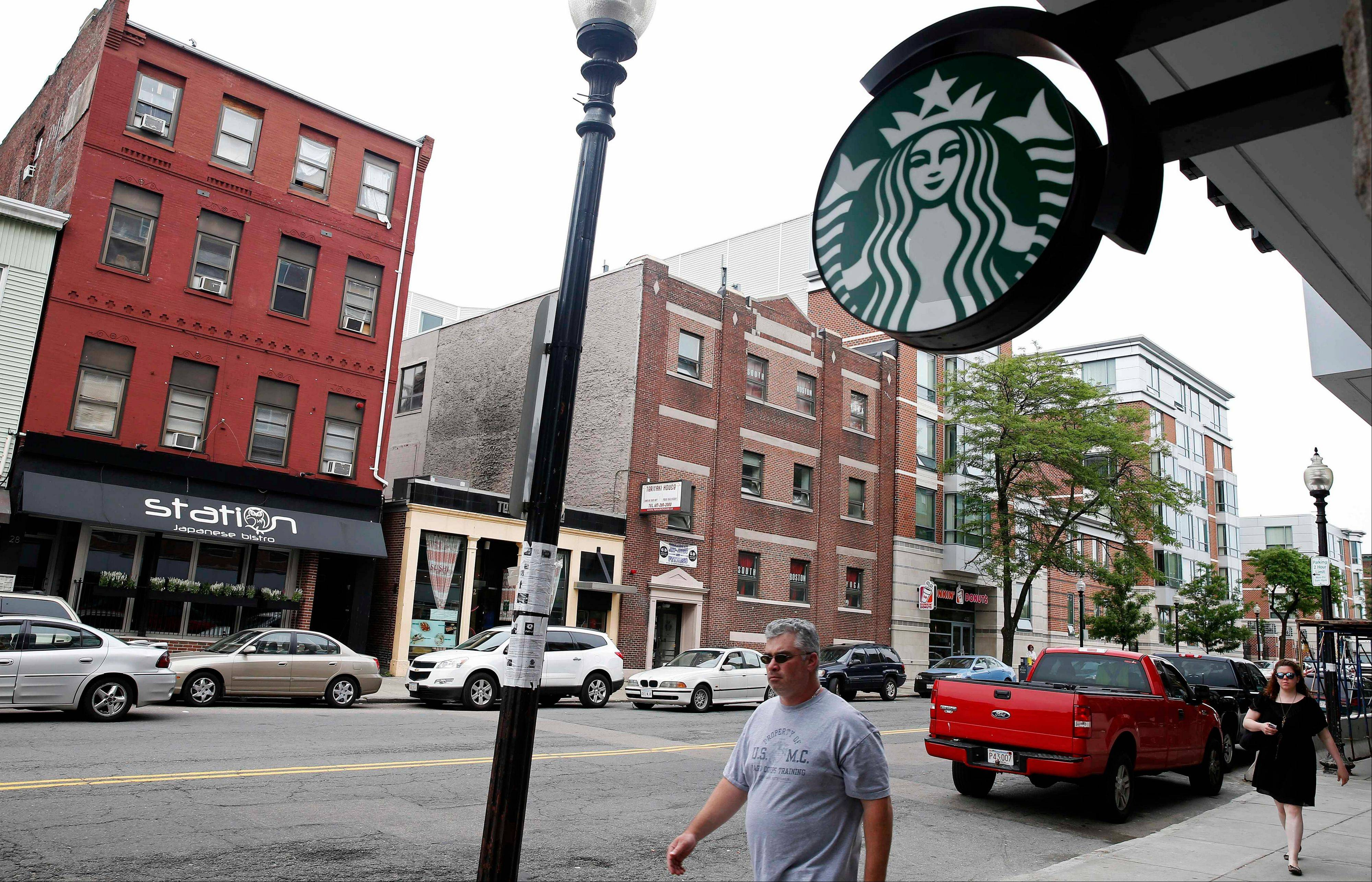 "A new Starbucks sits across the street from the building, left, which once housed the Triple O's bar in the South Boston neighborhood of Boston. Four decades after Boston crime boss James ""Whitey"" Bulger first rose to power, ""Southie"" is not what it used to be. The once blue-collar, Irish-Catholic neighborhood, is now an ethnic melting pot that has been invaded by young urban professionals who have gentrified the area and smoothed out its once-rough edges."
