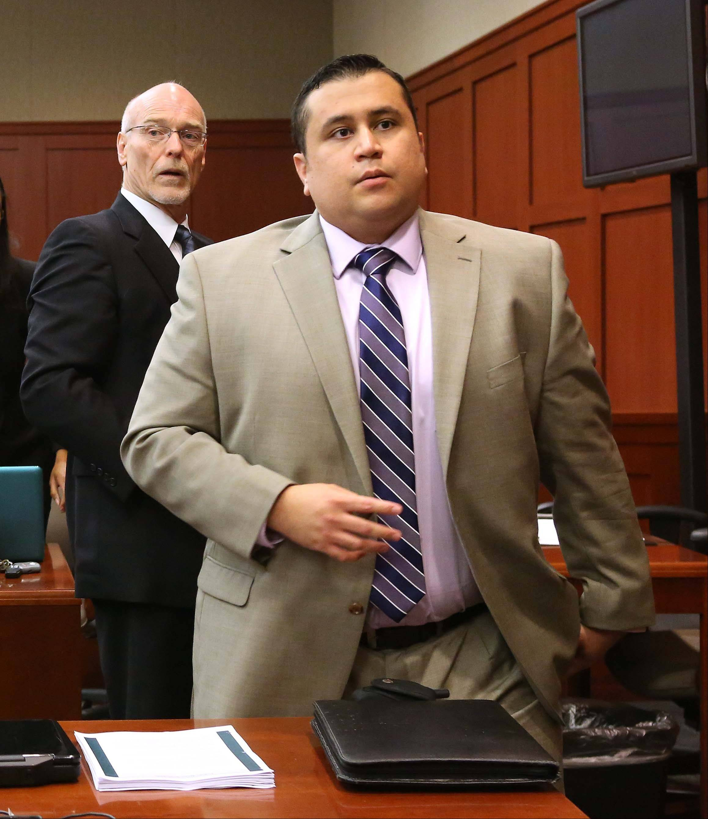 George Zimmerman, right, and attorney Don West, stand as the judge enters the courtroom in Seminole circuit court for a pretrial hearing in Sanford, Fla., Saturday. Jury selection begins Monday in the second-degree murder trial, which is expected to last about six weeks.