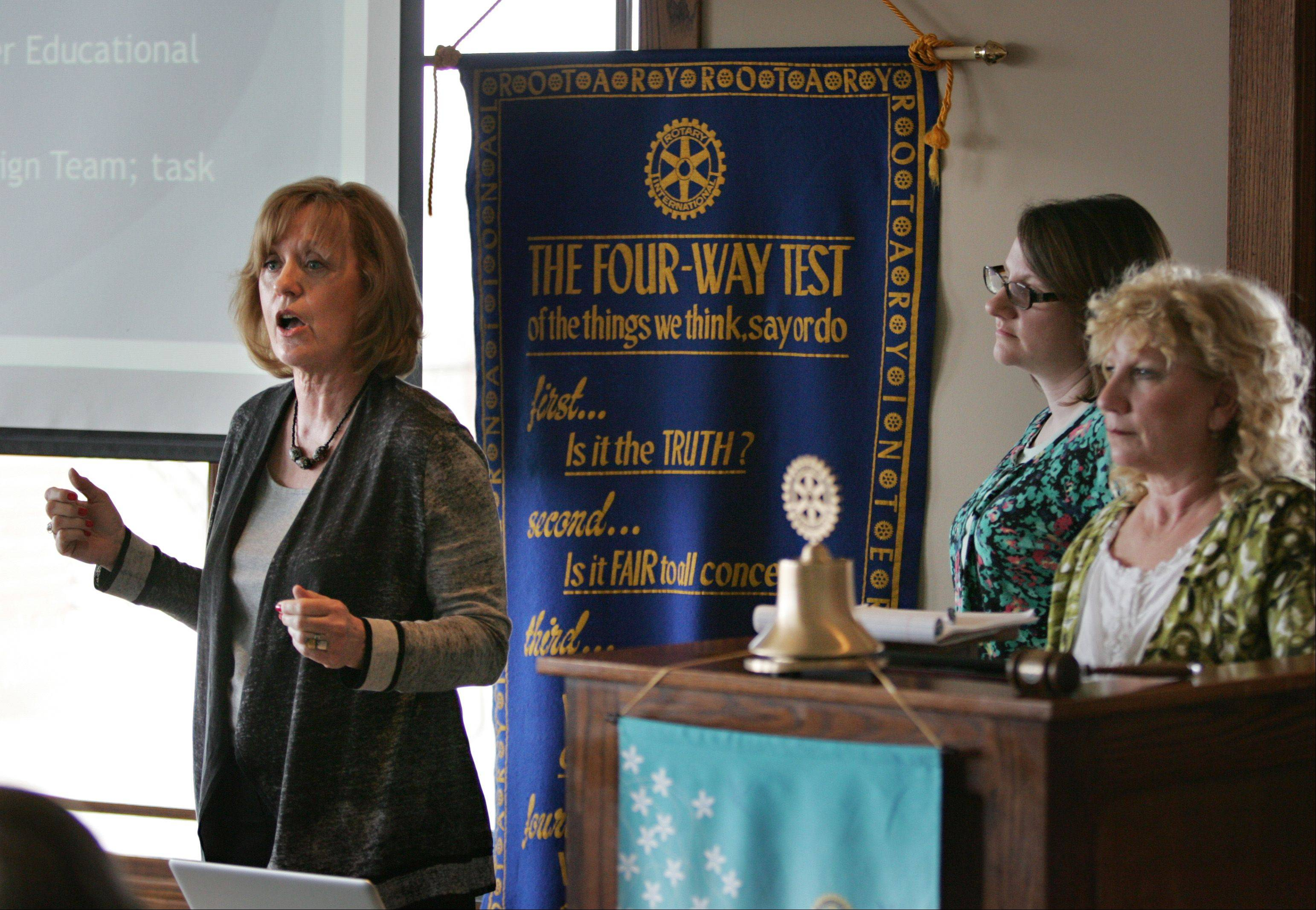 Karen Schock of the Elgin Charter School Initiative talks to members of the Elgin Noon Rotary Club on April 15 at the Hickory Stick restaurant in Elgin. Also pictured are Kari White, center, and Krissy Palermo, right.