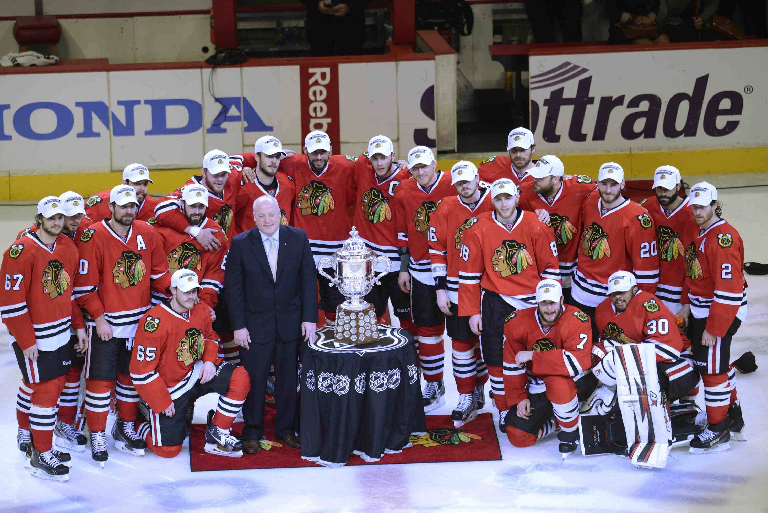 Chicago Blackhawks pose with the Campbell Cup after beating the Los Angeles Kings Saturday for the NHL Western Conference Championship at the United Center in Chicago.