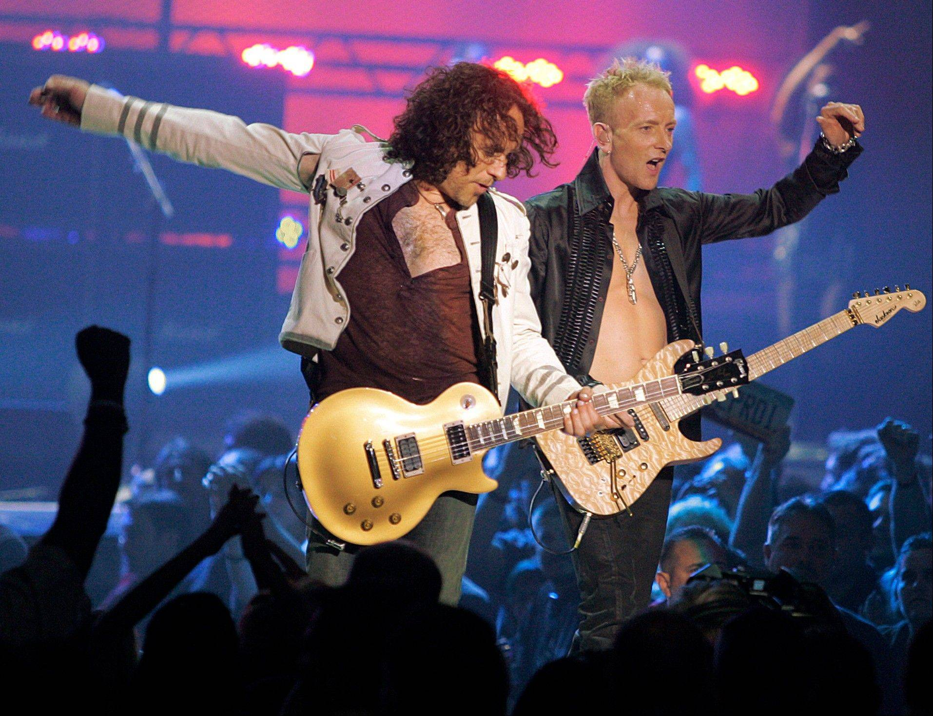 Vivian Campbell, left, of rock group Def Leppard revealed that he has Hodgkin's Lymphoma and has been in chemotherapy for two months, with four months to go.
