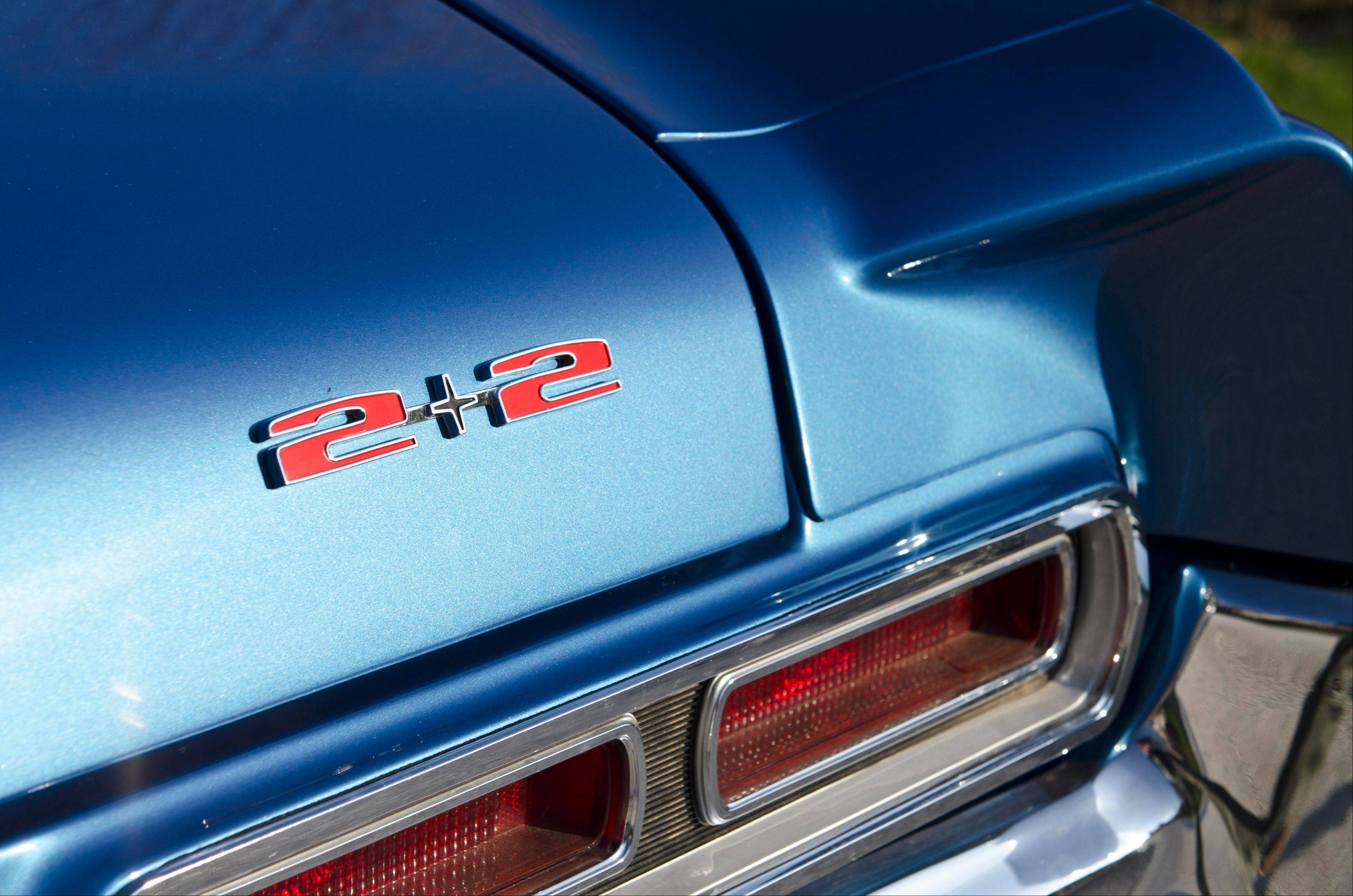 A 1966 Barrier Blue Pontiac 2+2 hardtop.