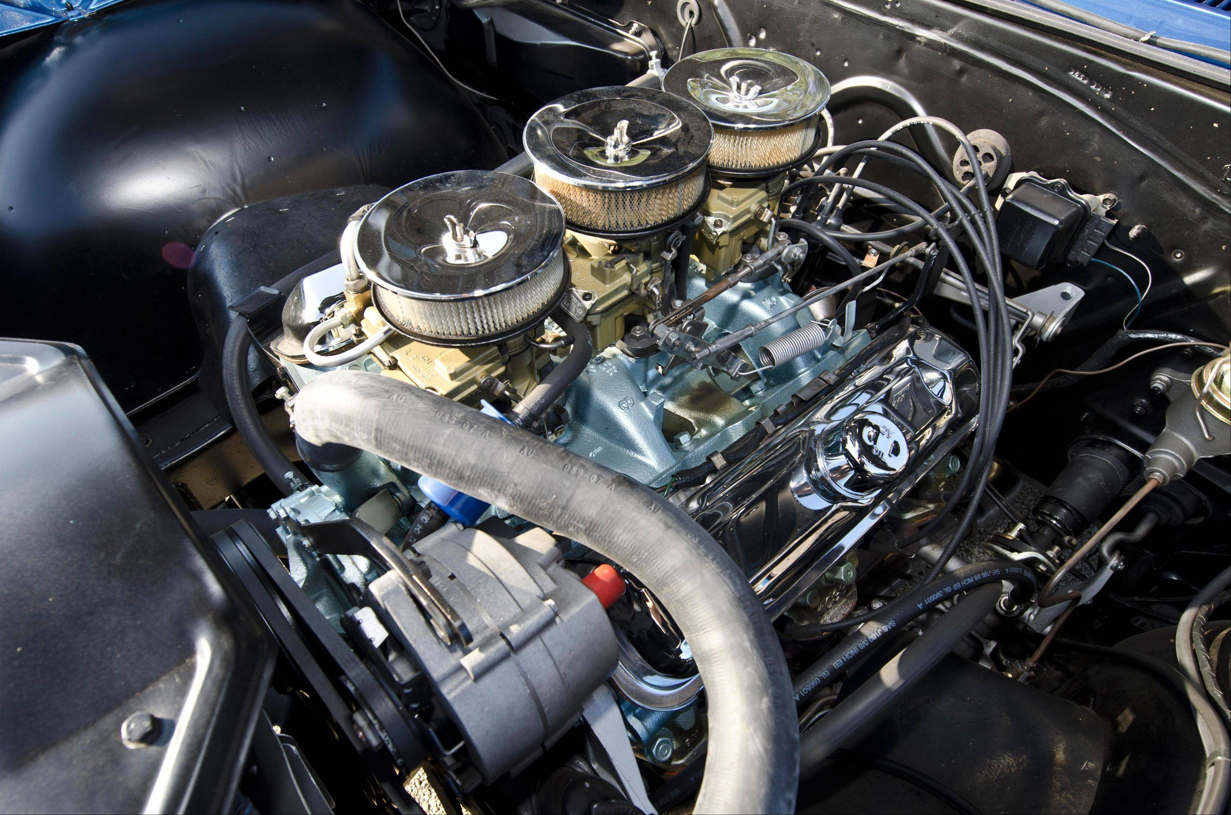 Boris' blue Pontiac 2+2 carries a 421-cubic-inch V-8 with factory tri-power carburetors.