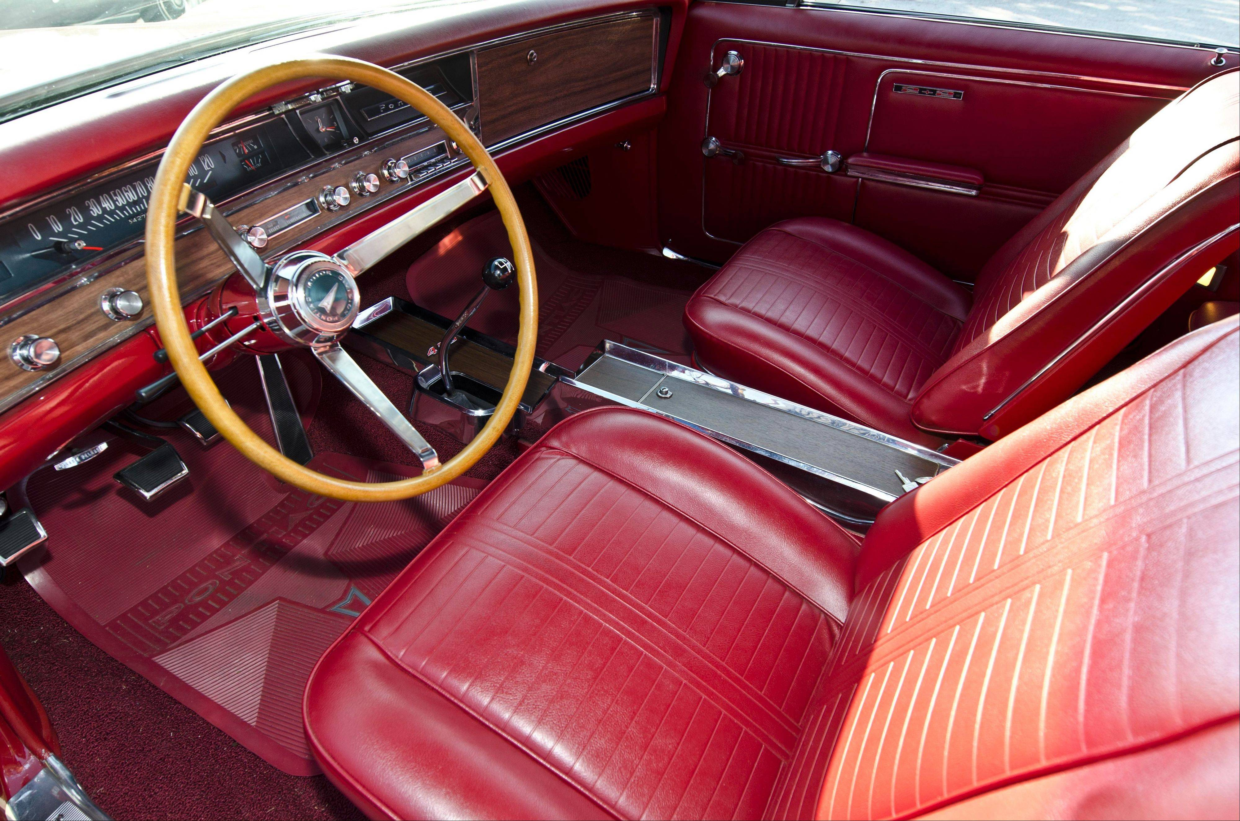 Boris, the third owner of this red 1967 Pontiac convertible, has been driving this 2+2 since 2005.