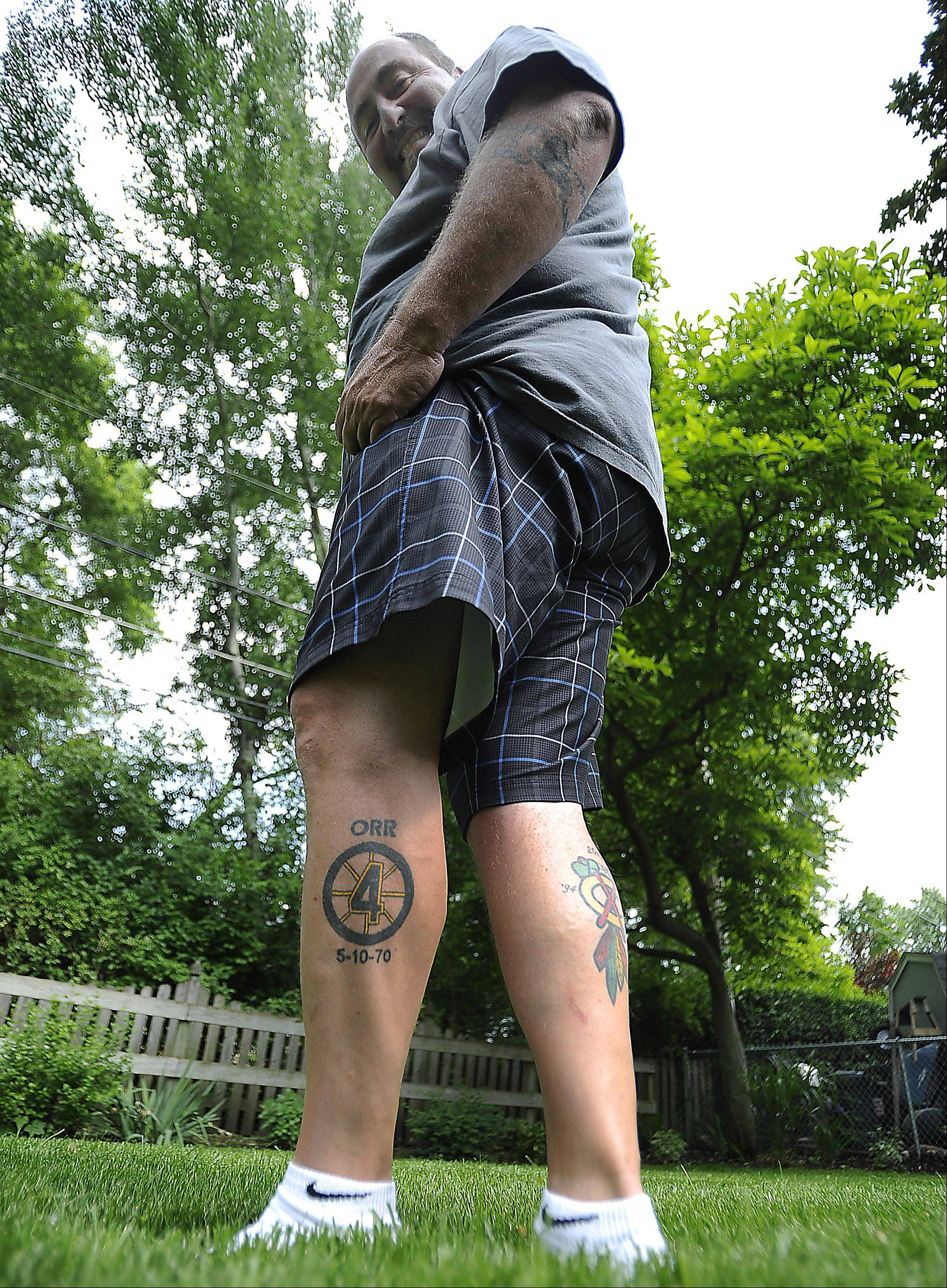Steve Lang of Mount Prospect has a Chicago Blackhawks tattoo on one leg and a tattoo honoring Boston Bruins player Bobby Orr on the other. Lang grew up in the Chicago area and says he has always been loyal to the Blackhawks, but as a kid he followed the Bruins closely and admired Orr.