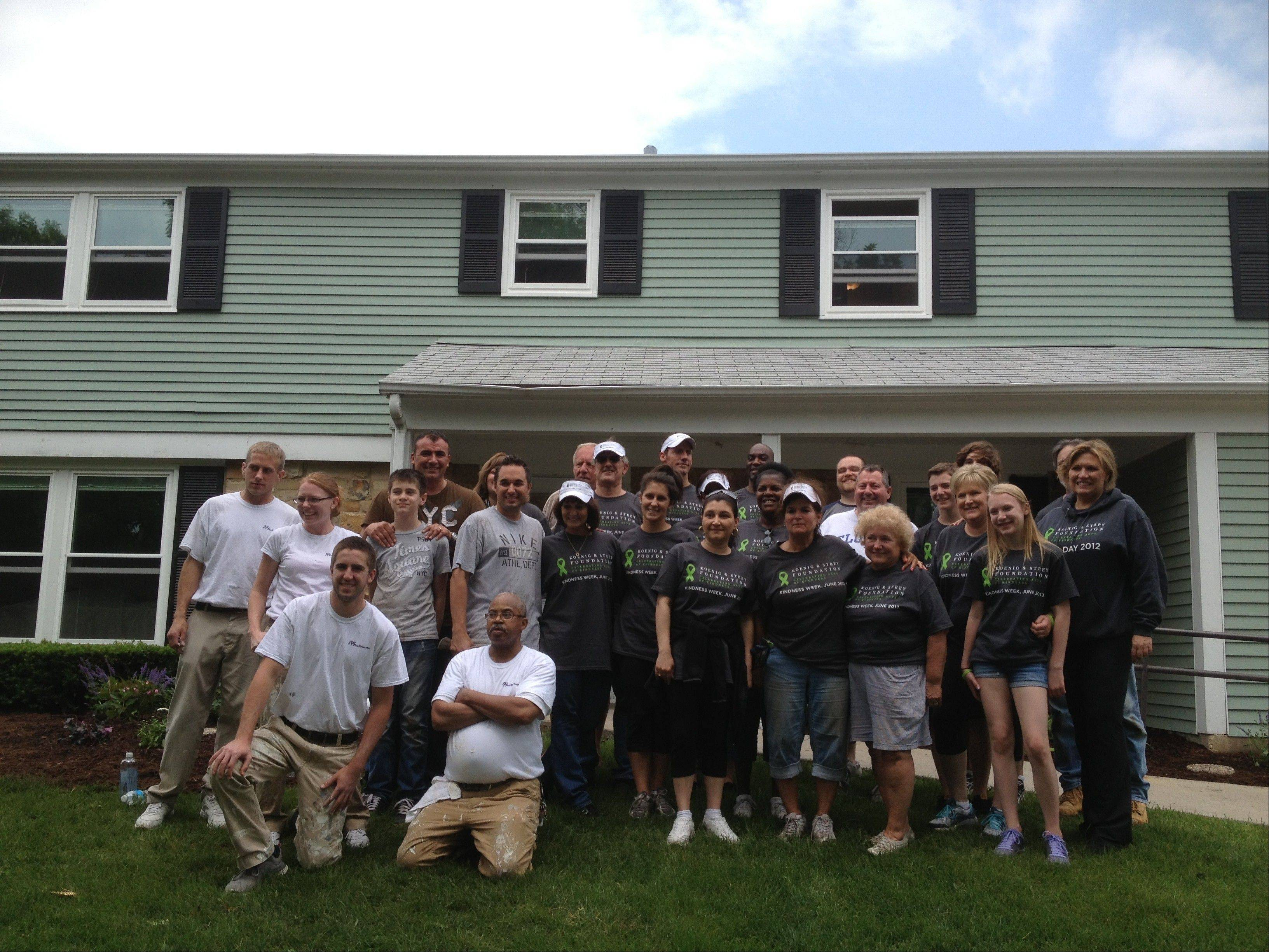 About 30 volunteers helped renovate two Schaumburg group homes Monday operated by Palatine-based Little City. The effort was part of the real estate firm Koenig & Strey's first Kindness Week.