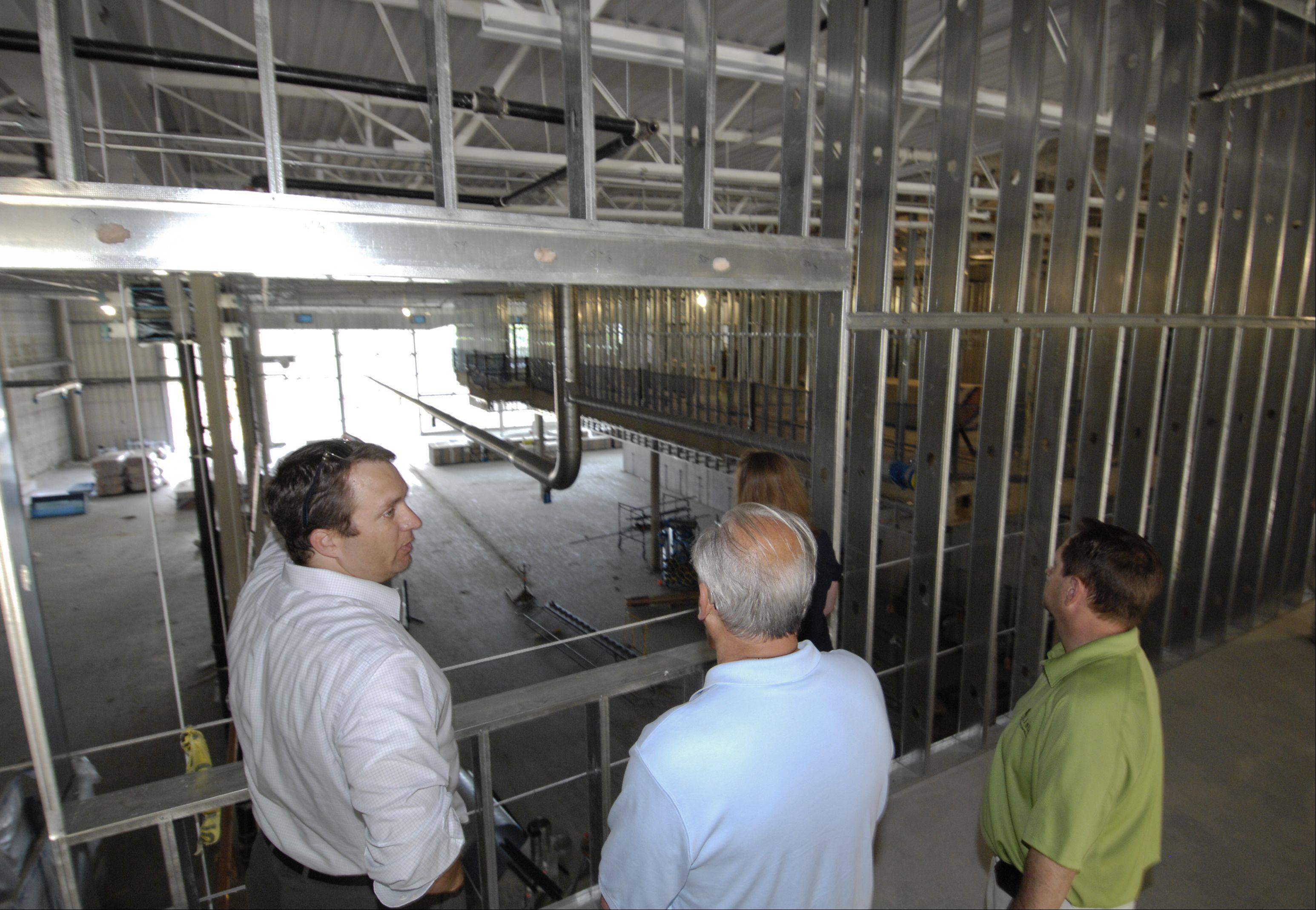 Tim Stoeckel, senior project manager at Jones Lang LaSalle, gives Lisle officials, including Mayor Joe Broda, a tour of the Universal Technical Institute construction site.