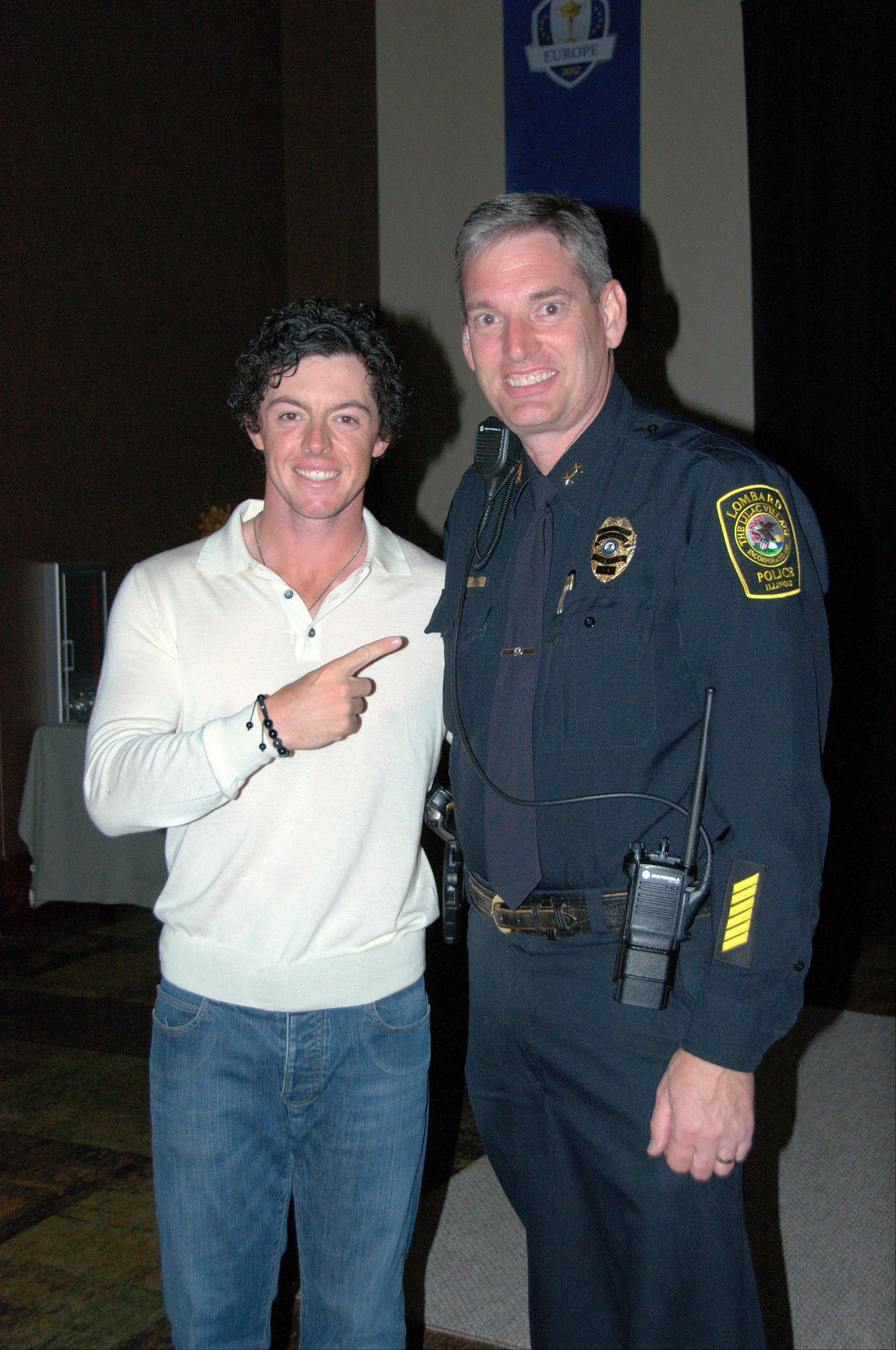 Irish golfer Rory McIlroy, left, credits Lombard Deputy Chief Pat Rollins with getting him to the Ryder Cup on time last fall. Rollins is going to be Sughar Grove's new police chief.