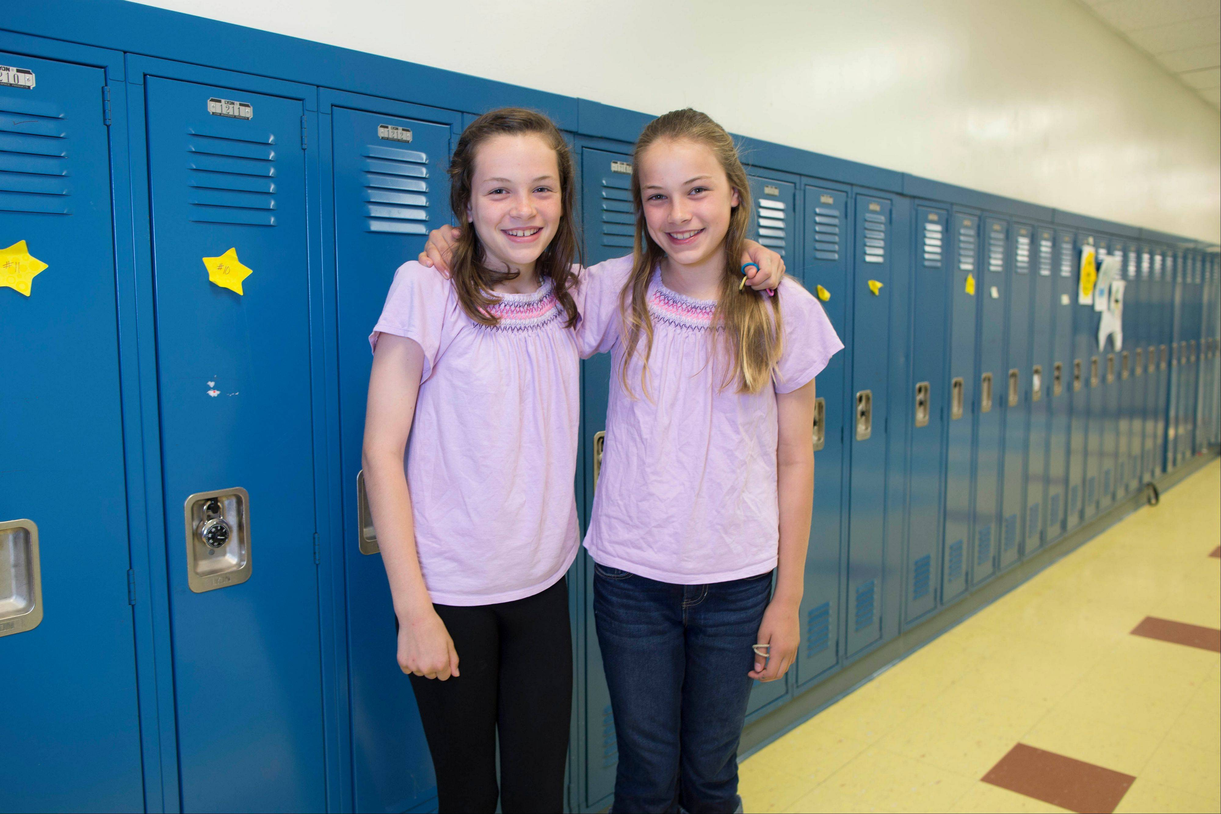 Emma Merk, left, and her twin sister, Katie.