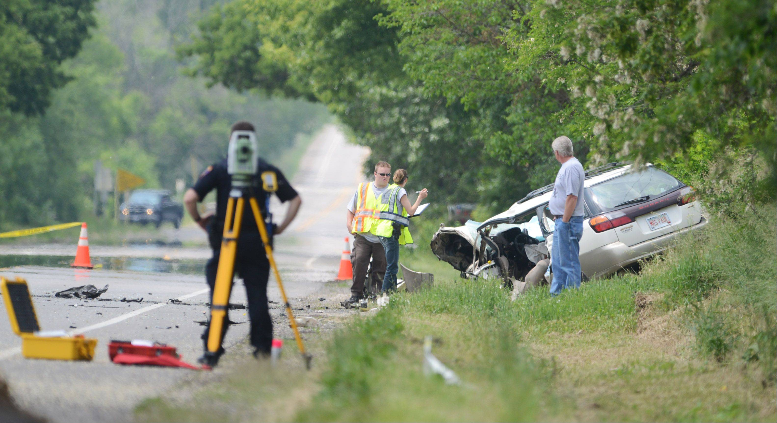 Officials investigate a fatal crash Monday on Route 173 near Fox Lake.