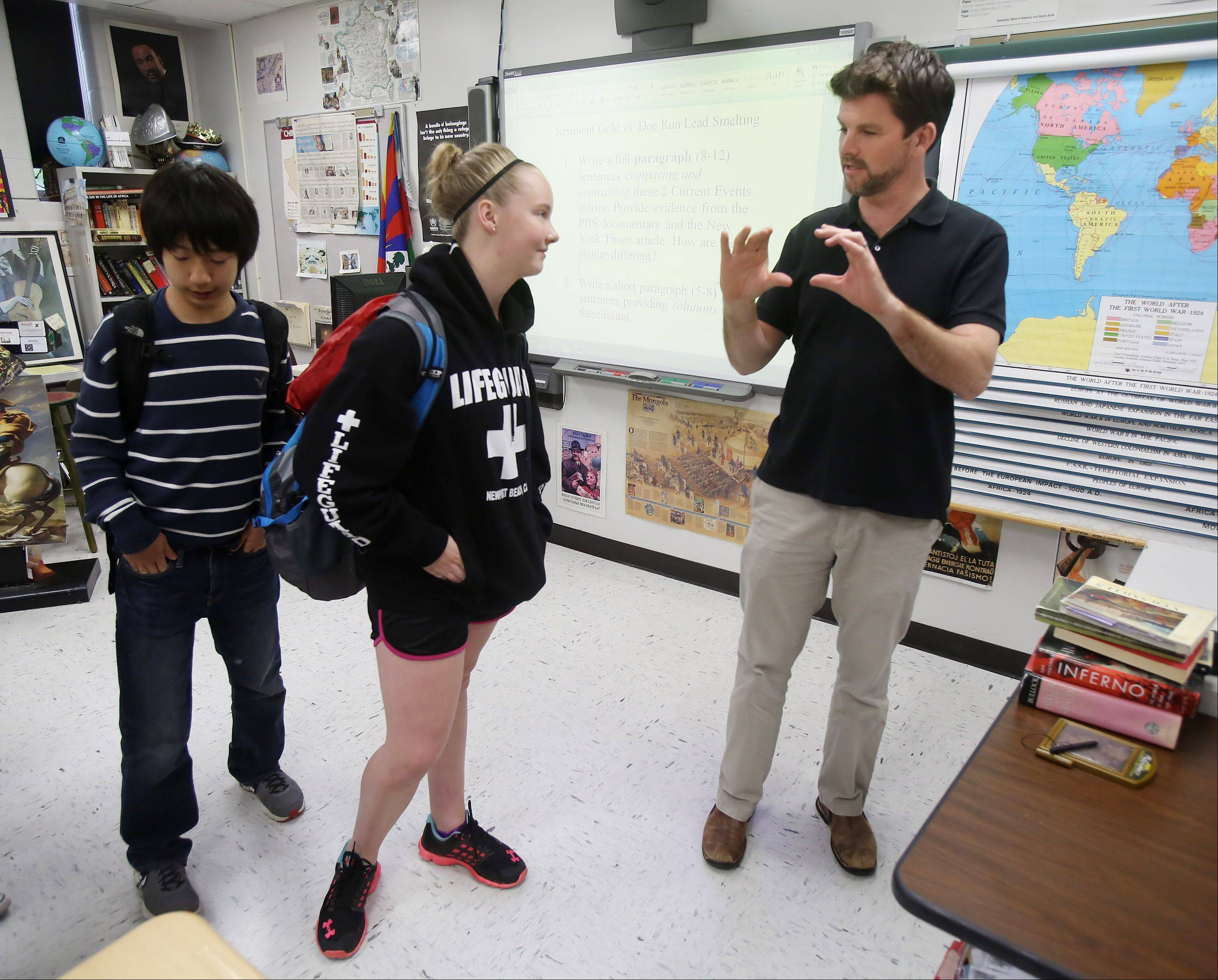 Mundelein High School teacher Neil McCarthy talks to freshman Tara Lawson after class.