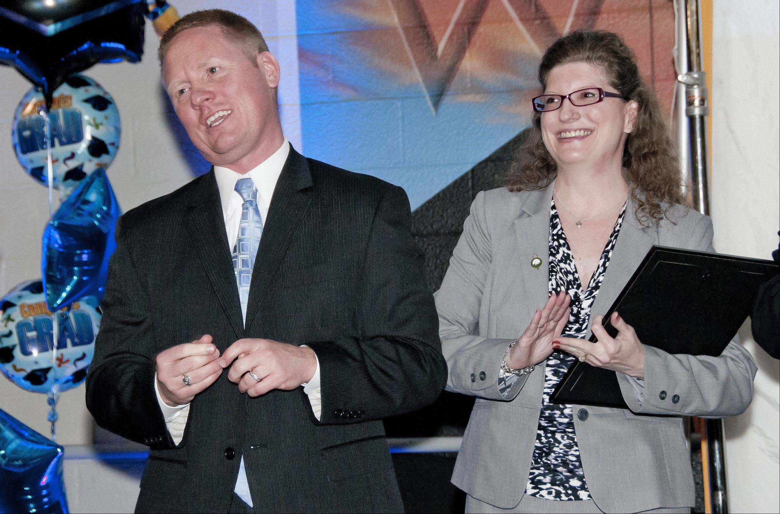 Villa Park Village President Deborah Bullwinkel applauds Willowbrook High School principal Dan Krause on being named Illinois Principal of the Year during a ceremony in May at the Villa Park school.