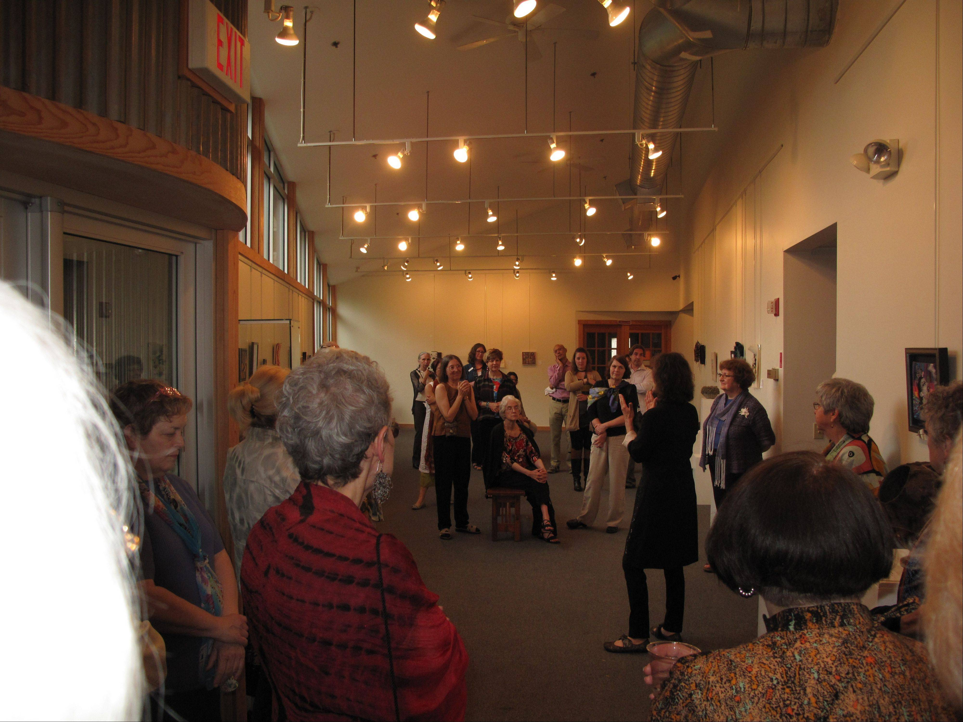 The crowd listens to Handweavers Guild of America juror Laura Foster Nicholson during her gallery talk at the Small Expressions opening reception at the Fine Line Creative Arts Center. The St. Charles gallery will soon have a new address and entrance.