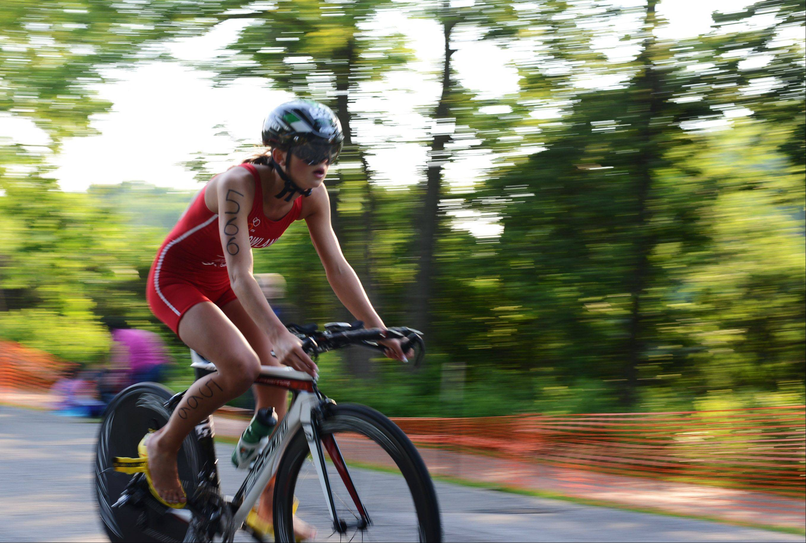 Jenn Howland, of Elburn, comes to the end of the biking portion of the tenth annual Batavia Triathlon Sunday.