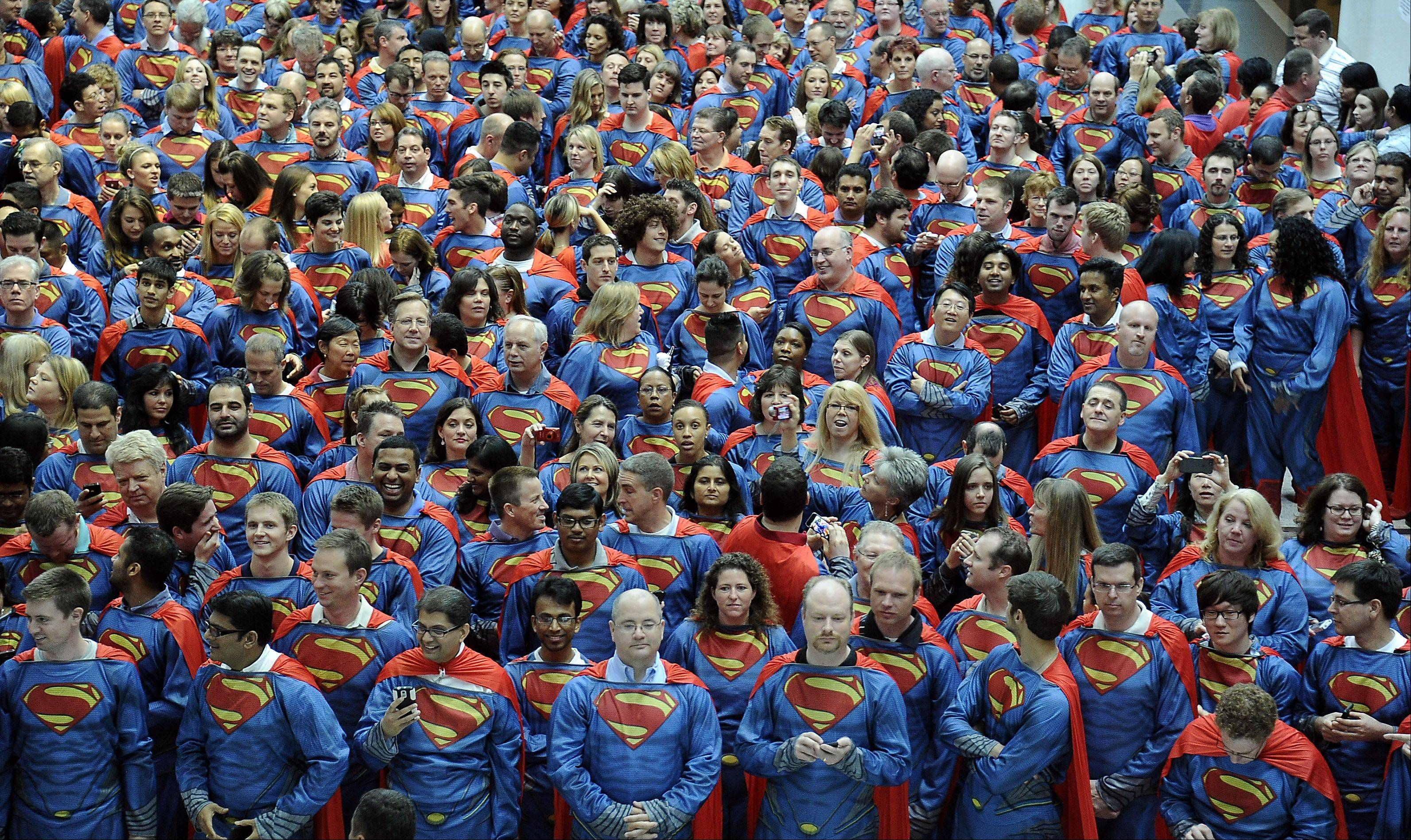 "Sears and Warner Bros. Pictures teamed up to set a new world record with 600 sears employees dressed as Superman, and celebrate the opening of ""Man of Steel"" movie in Hoffman Estates Wednesday."