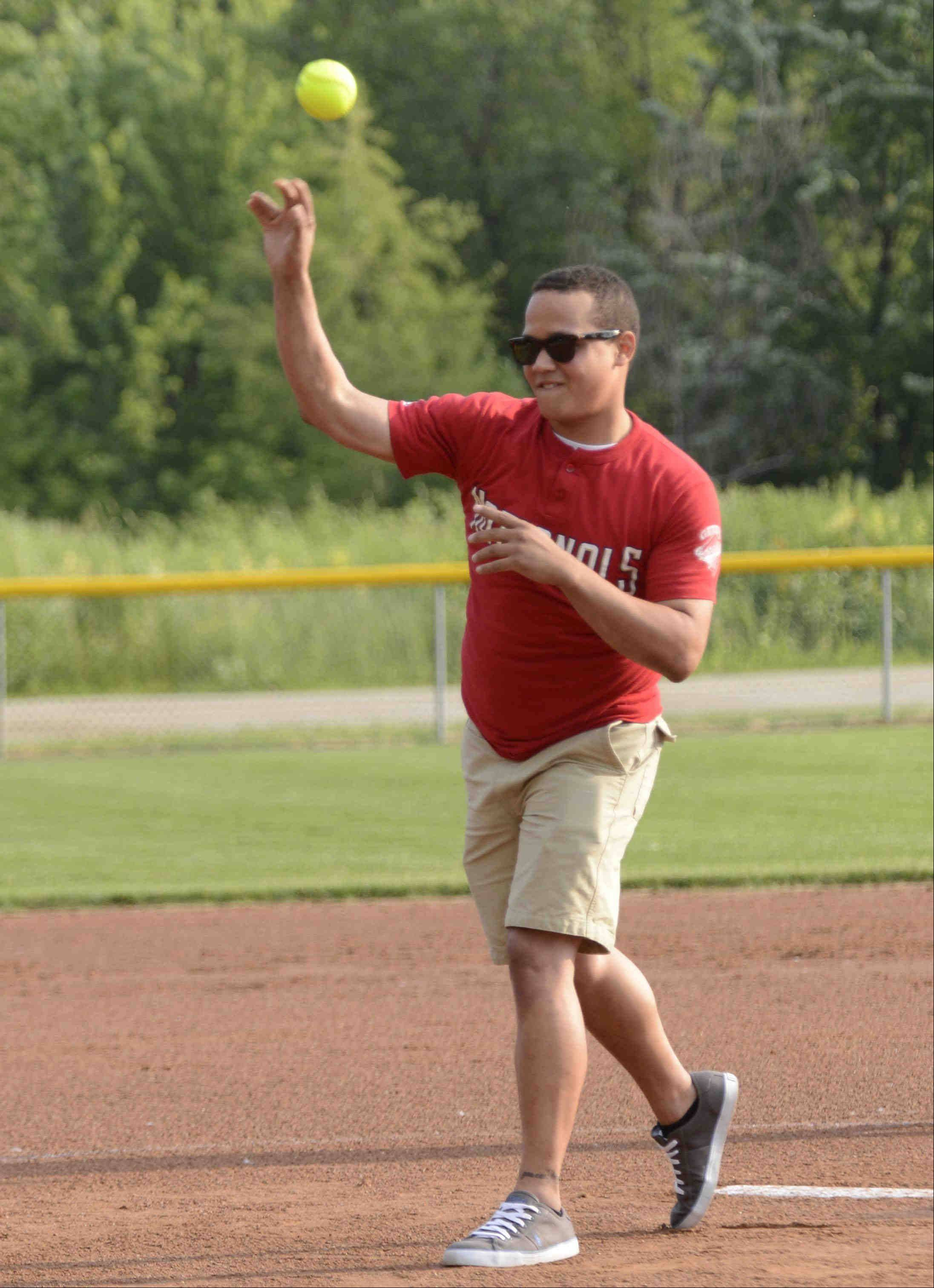 Christopher Fehlman throws the ceremonial first pitch Monday during the Tenth Annual Fehlman Memorial Senior All-Star softball game at Judson University. The game, which ended in a 4-4 tie, is named in memory of Christoper's father, Dave, who passed away in 2007, and Robbie Fehlman, Christoper's brother, who was killed by a motorist late last summer.