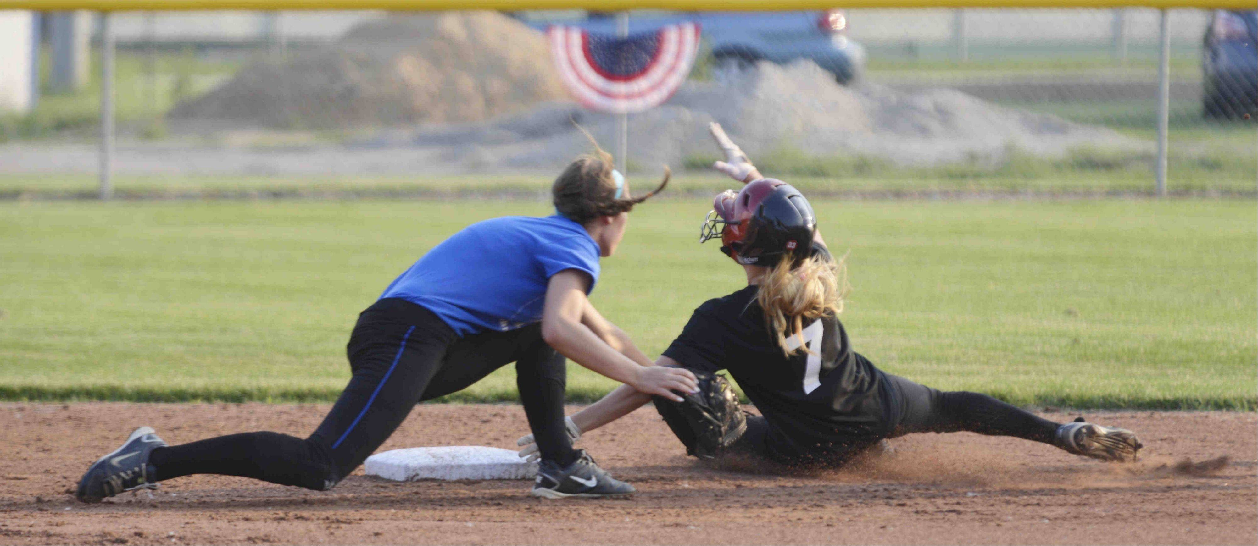 East All Star Rachel Odolski is tagged out at second by West All Star shortstop Kali Kossakowski Monday during the Tenth Annual Fehlman Memorial Senior All-Star softball game at Judson University.