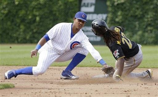 Chicago Cubs shortstop Starlin Castro, left, tags out Pittsburgh Pirates Andrew McCutchen during Sunday's game in Chicago. Castro entered Monday night's game against the Cincinnati Reds in a horrible 3-for-38 slump.