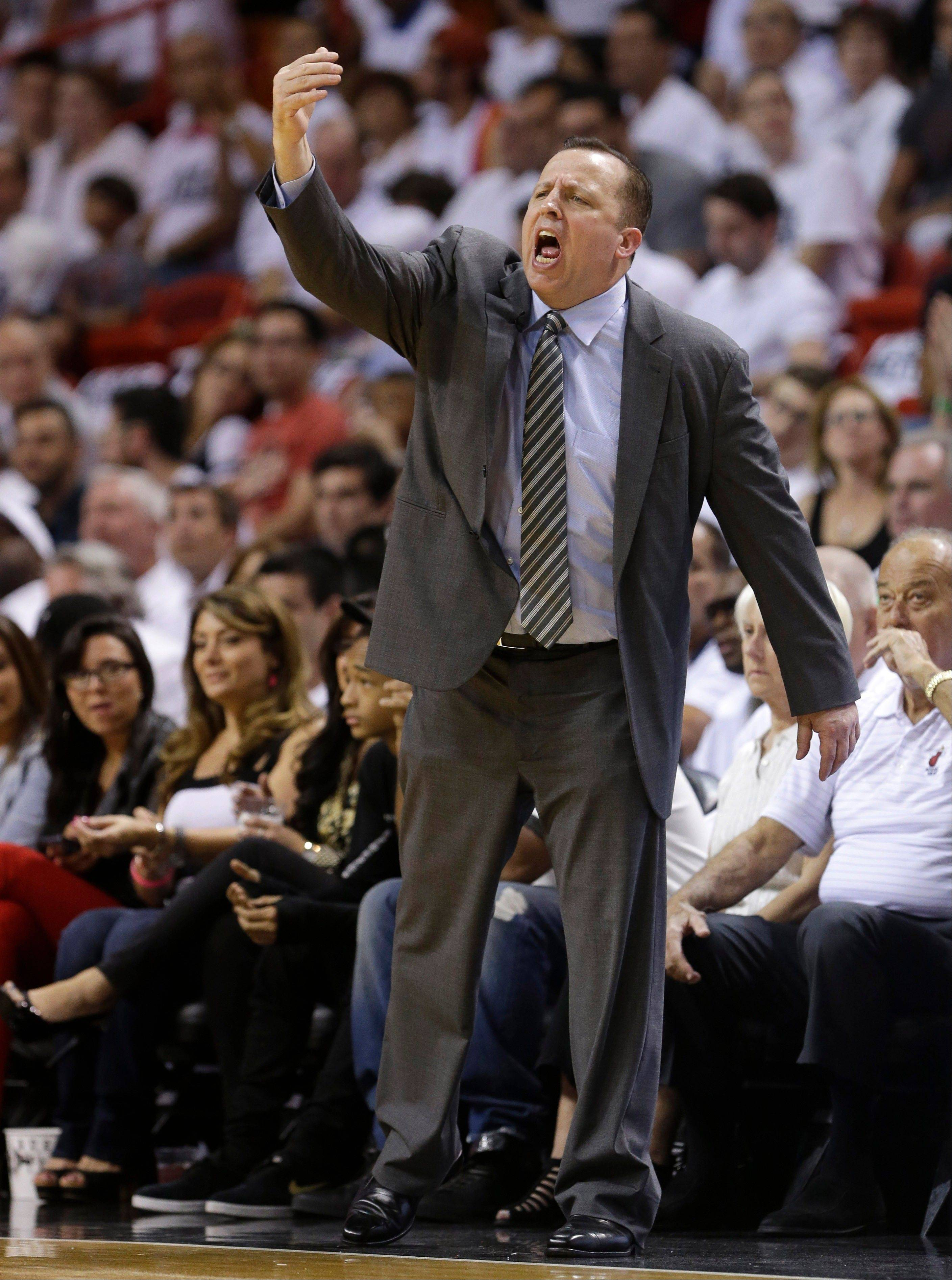 Chicago Bulls coach Tom Thibodeau gestures during the first half of Game 5 of an NBA basketball Eastern Conference semifinal against the Miami Heat, Wednesday, May 15, 2013, in Miami.