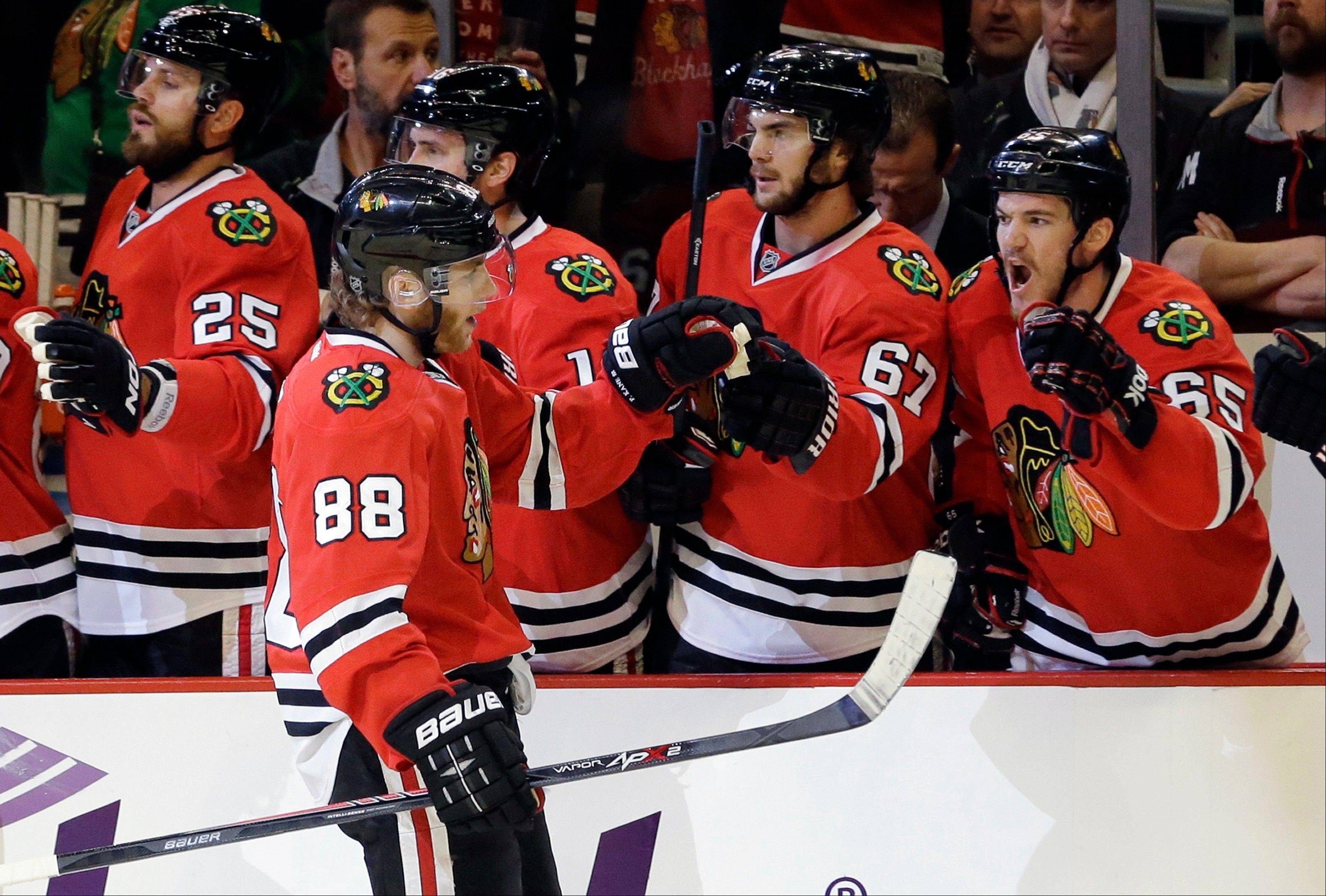 Chicago Blackhawks right wing Patrick Kane (88) celebrates with his teammates after scoring a goal during the first period in Game 5 of the NHL hockey Stanley Cup playoffs Western Conference finals against the Los Angeles Kings, Saturday, June 8, 2013, in Chicago.
