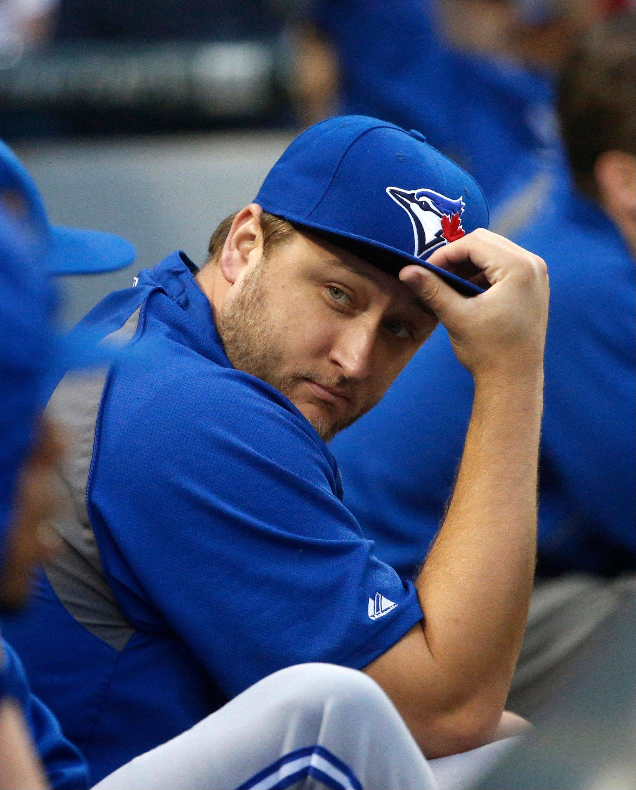 Toronto Blue Jays pitcher Mark Buehrle, former Chicago White Sox ace, sits in the dugout during the third inning of a baseball game Monday, June 10, 2013, in Chicago. Buehrle returned to U.S. Cellular Field for the first time after leaving the White Sox at the end of the 2011 season.