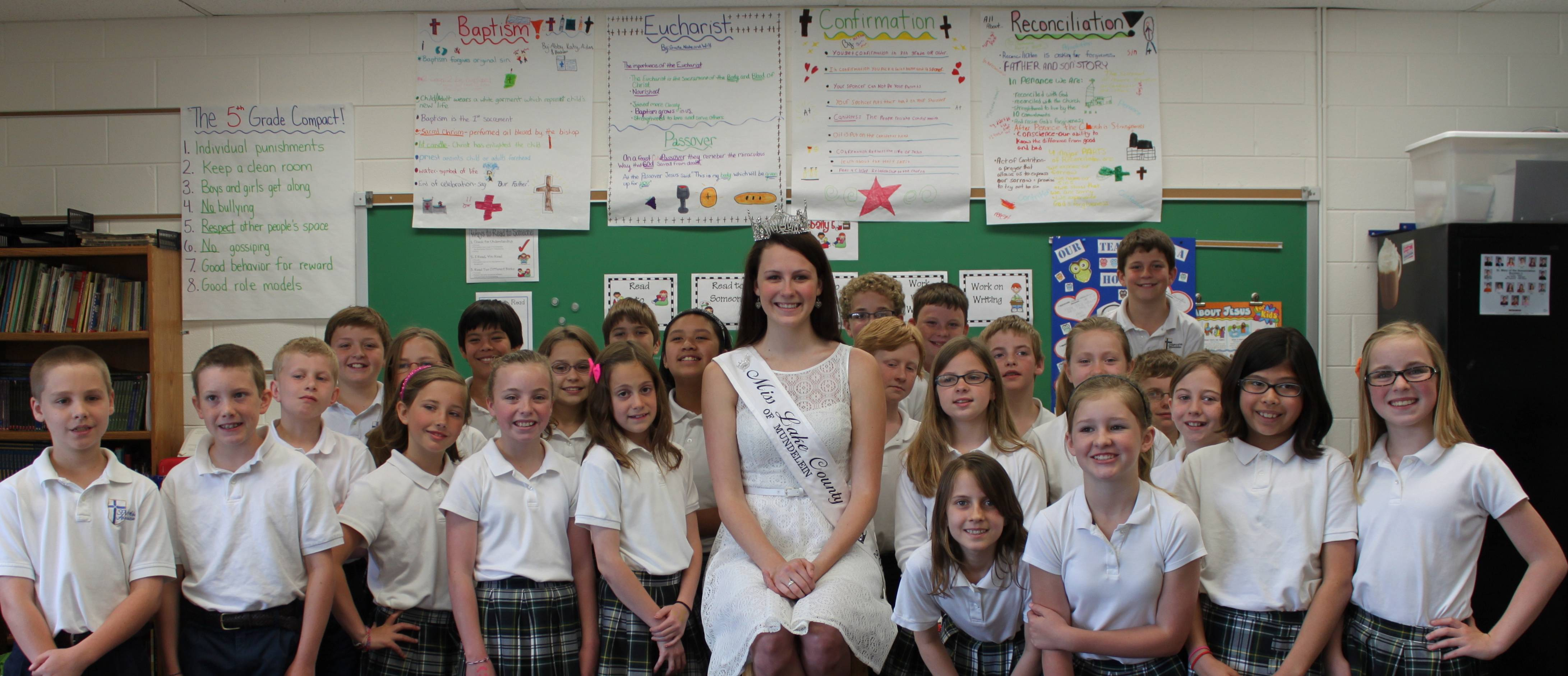 Miss Lake County, Shannon Baucus, surrounded by fourth and fifth grade students at St. Mary of the Annunciation School.