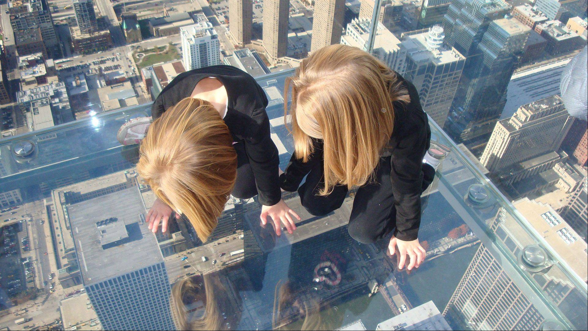 Two sisters, Gracie and Jillian Bouchard, had no problem being �on top of the world� atop the Willis Tower Ledge in downtown Chicago this past Veterans Day.