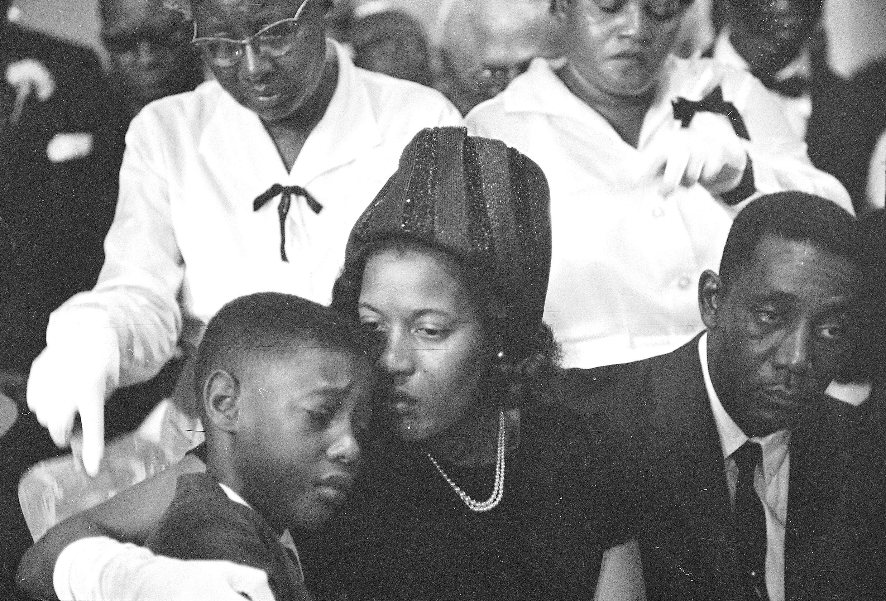 Myrlie Louise Evers comforts her 9-year-old son, Darrel, at the funeral in Jackson, Miss. for slain integration leader Medgar Evers. Several events are being held to remember Evers, the first Mississippi field secretary of the National Association for the Advancement of Colored People. He was 37 when he was assassinated outside the family�s north Jackson home on June 12, 1963.
