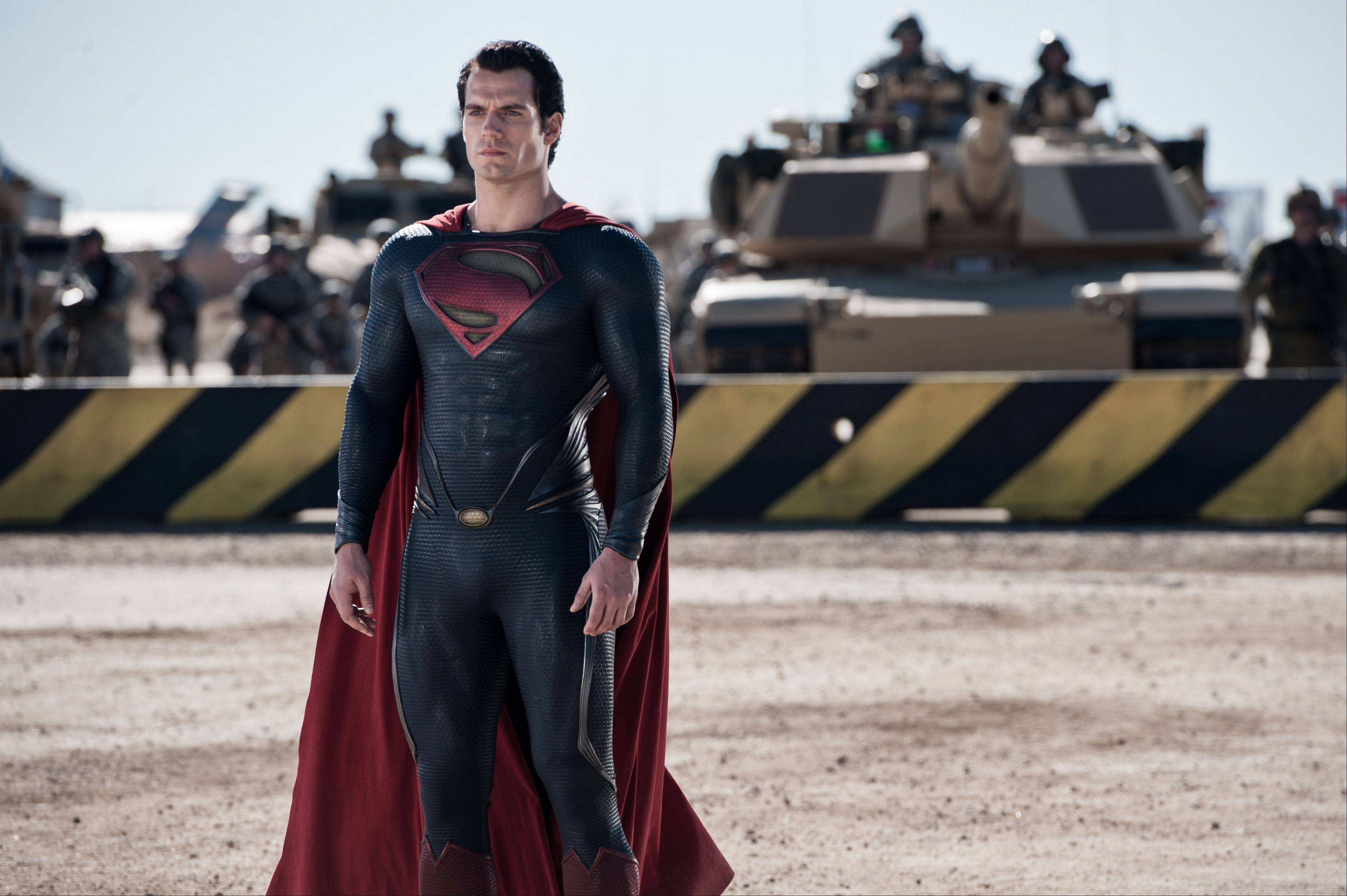 "Clark Kent (Henry Cavill) emerges as Superman in the dour retelling of the comic book hero's origin in ""Man of Steel."""