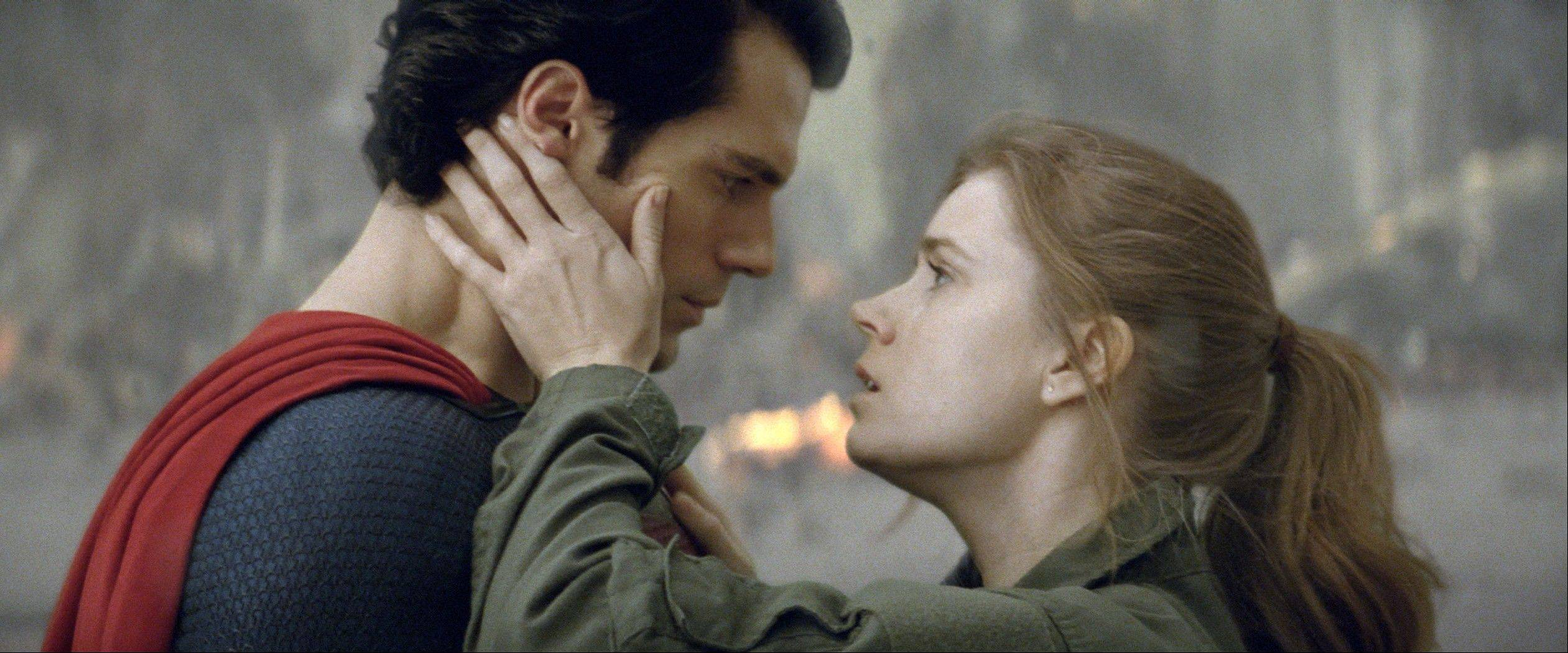 "Superman (Henry Cavil) shares an awkward romantic moment with Lois Lane (Amy Adams) in ""Man of Steel."""