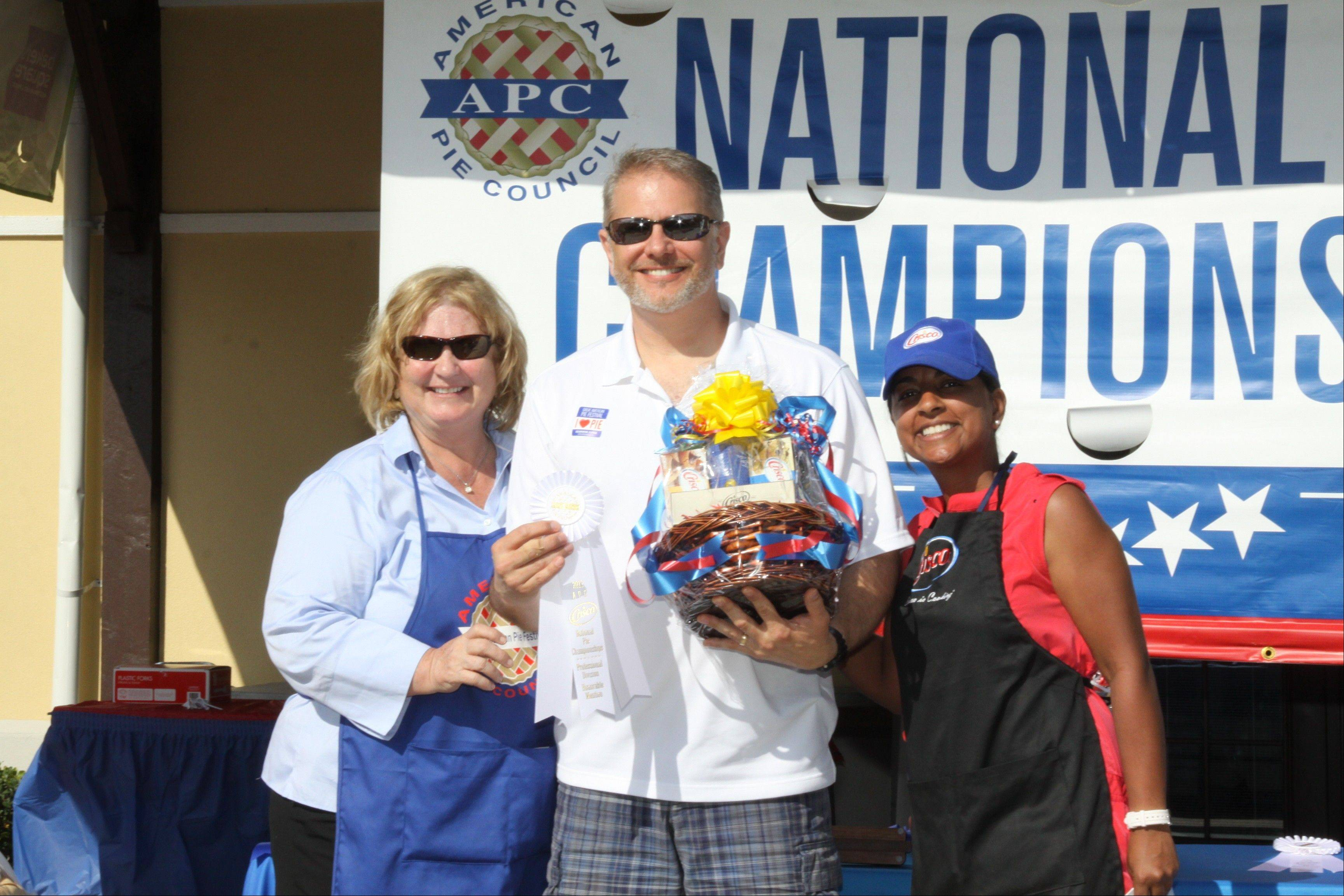 American Pie Council director Linda Hoskins congratulates Matt Zagorski of Arlington Heights on his second place win at the National Pie Championships in Orlando, Fla., in April.