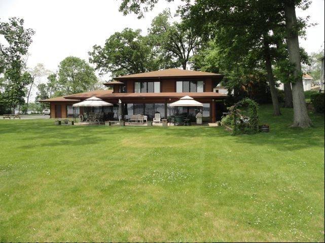 This recently-remodeled cedar home in Ingleside is located on Long Lake.
