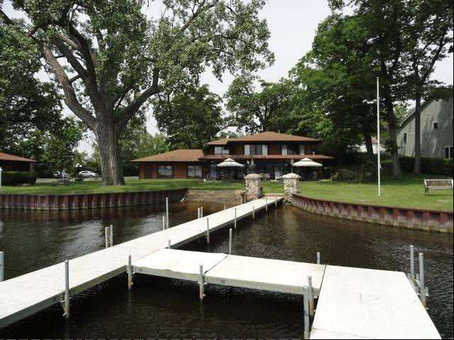 Homeowners enjoy their own backyard pier and boat ramp.