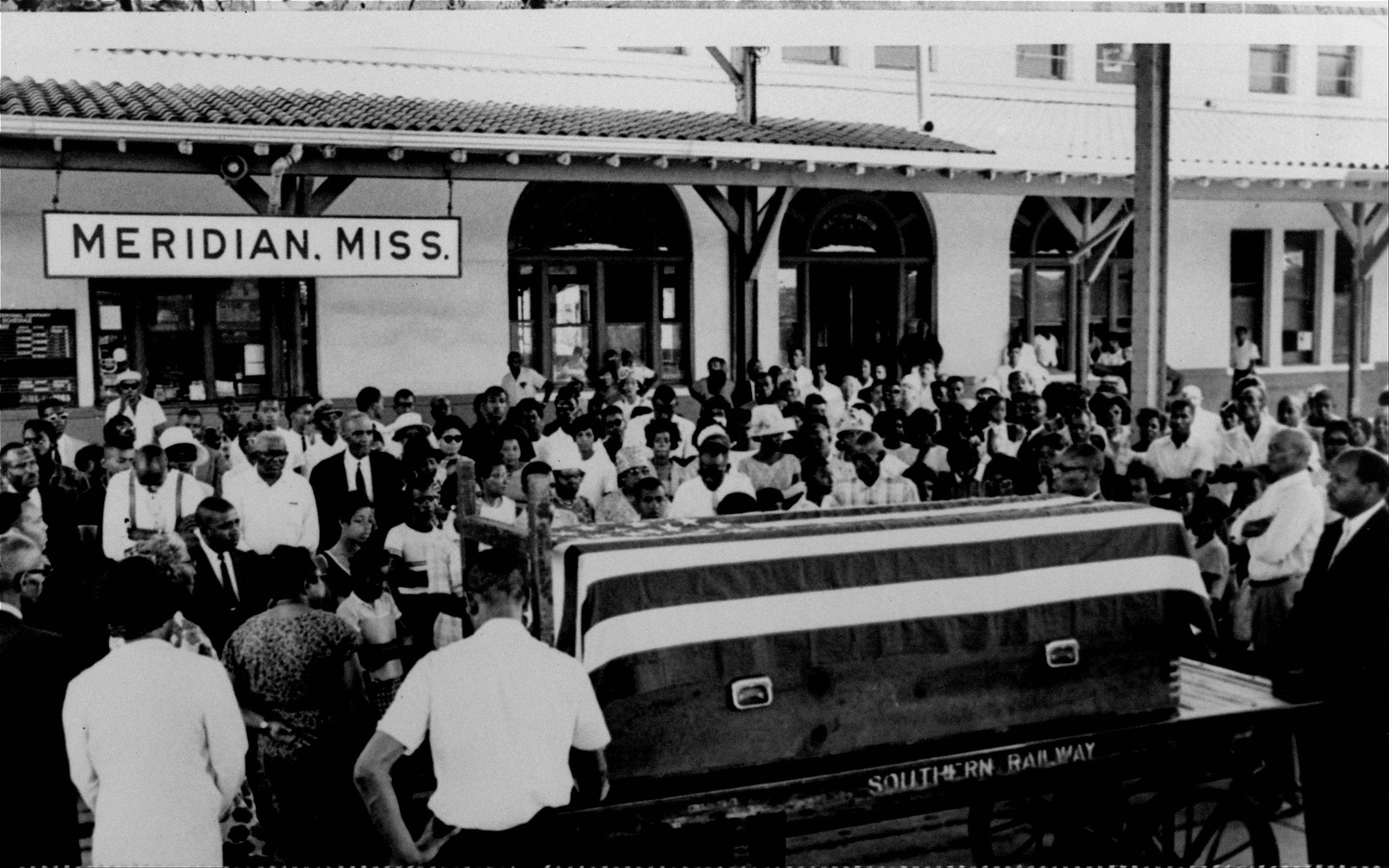 People hold a prayer meeting at the train station in Meridian, Miss., around the casket bearing the body of slain integration leader Medgar Evers in 1963.