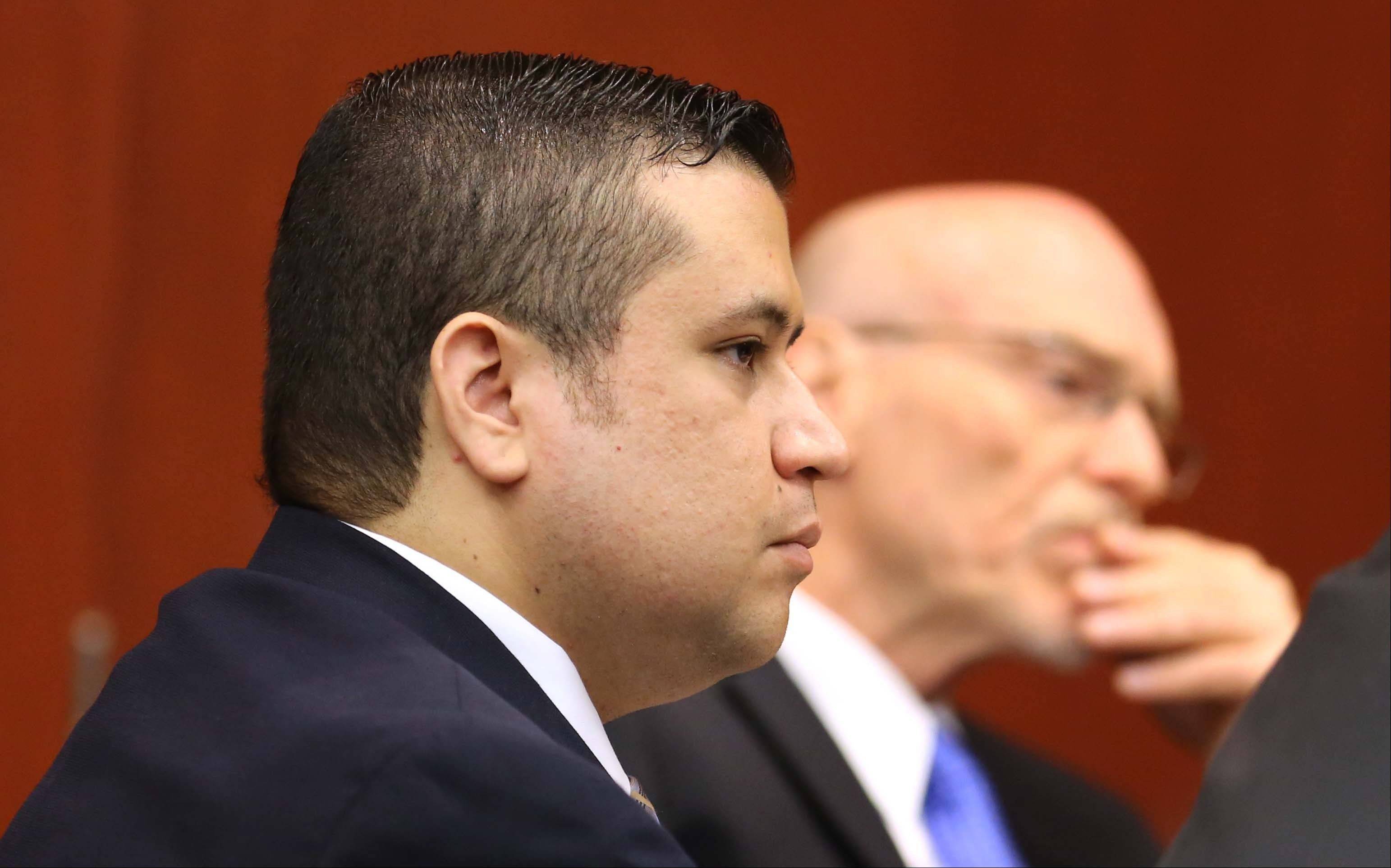 George Zimmerman, left, and defense attorney Don West listen to the questioning of prospective jurors in Seminole circuit court for his trial, in Sanford, Fla., Tuesday, June 11, 2013. Zimmerman has been charged with second-degree murder for the 2012 shooting death of Trayvon Martin.