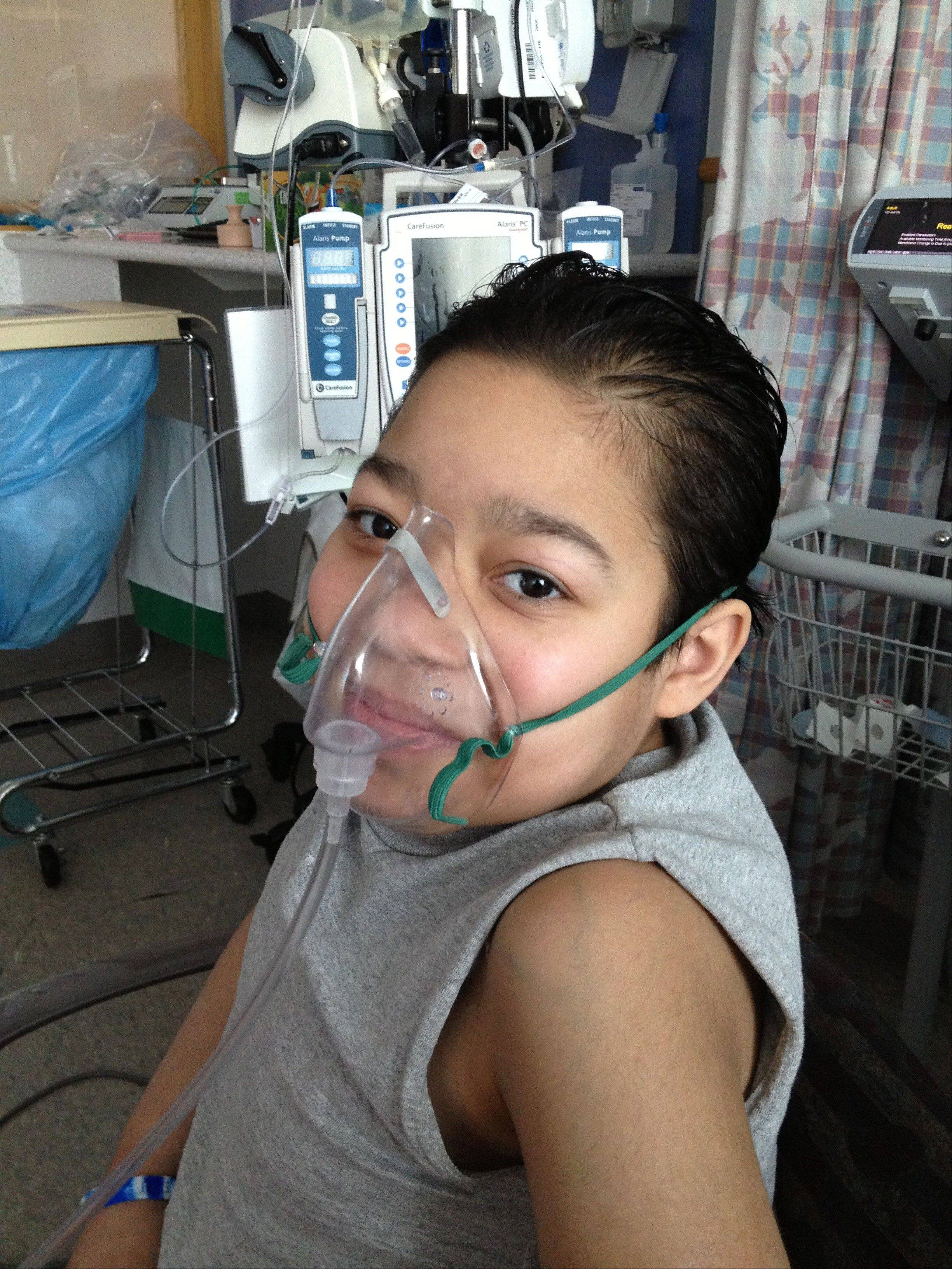 Javier Acosta, 11, of New York, who has cystic fibrosis and is in intensive care at Children's Hospital of Philadelphia, the same hospital where 10-year-old Sarah Murnaghan is a patient.