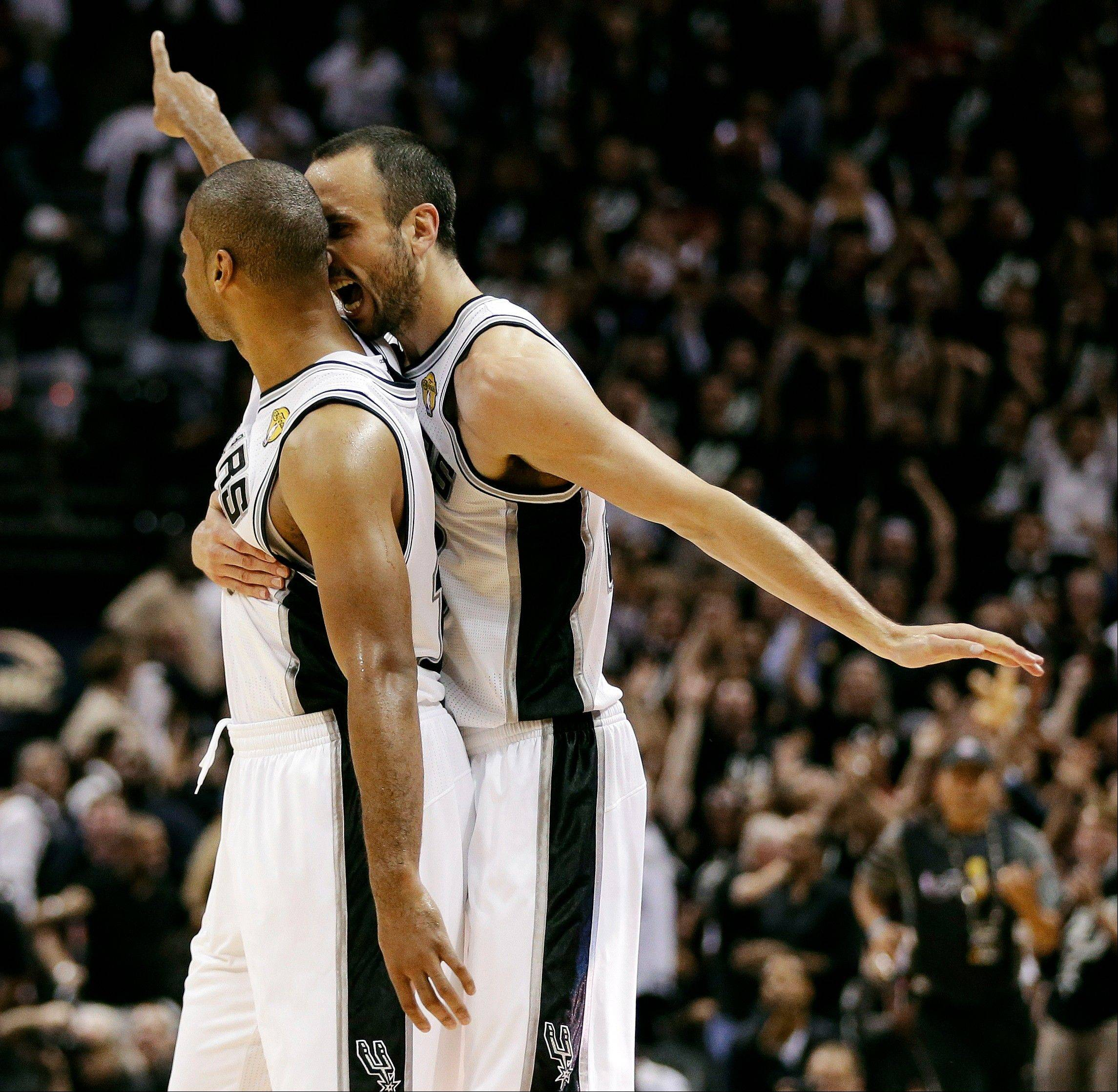 San Antonio Spurs' Gary Neal celebrates a 3-point basket -- one of 16 during the game against the Miami Heat Tuesday night. The Spurs beat the Heat 113-77 in Game 3 of the NBA Finals.