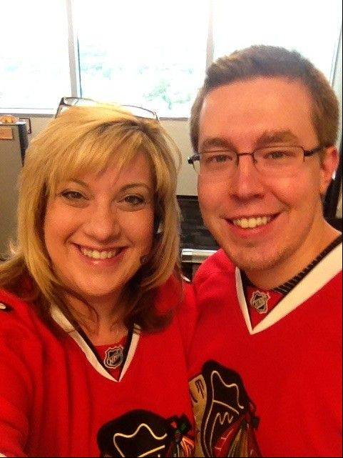 Cathy Hecht of Carol Stream and Dan Sadlowski wear Blackhawks gear on casual Fridays.