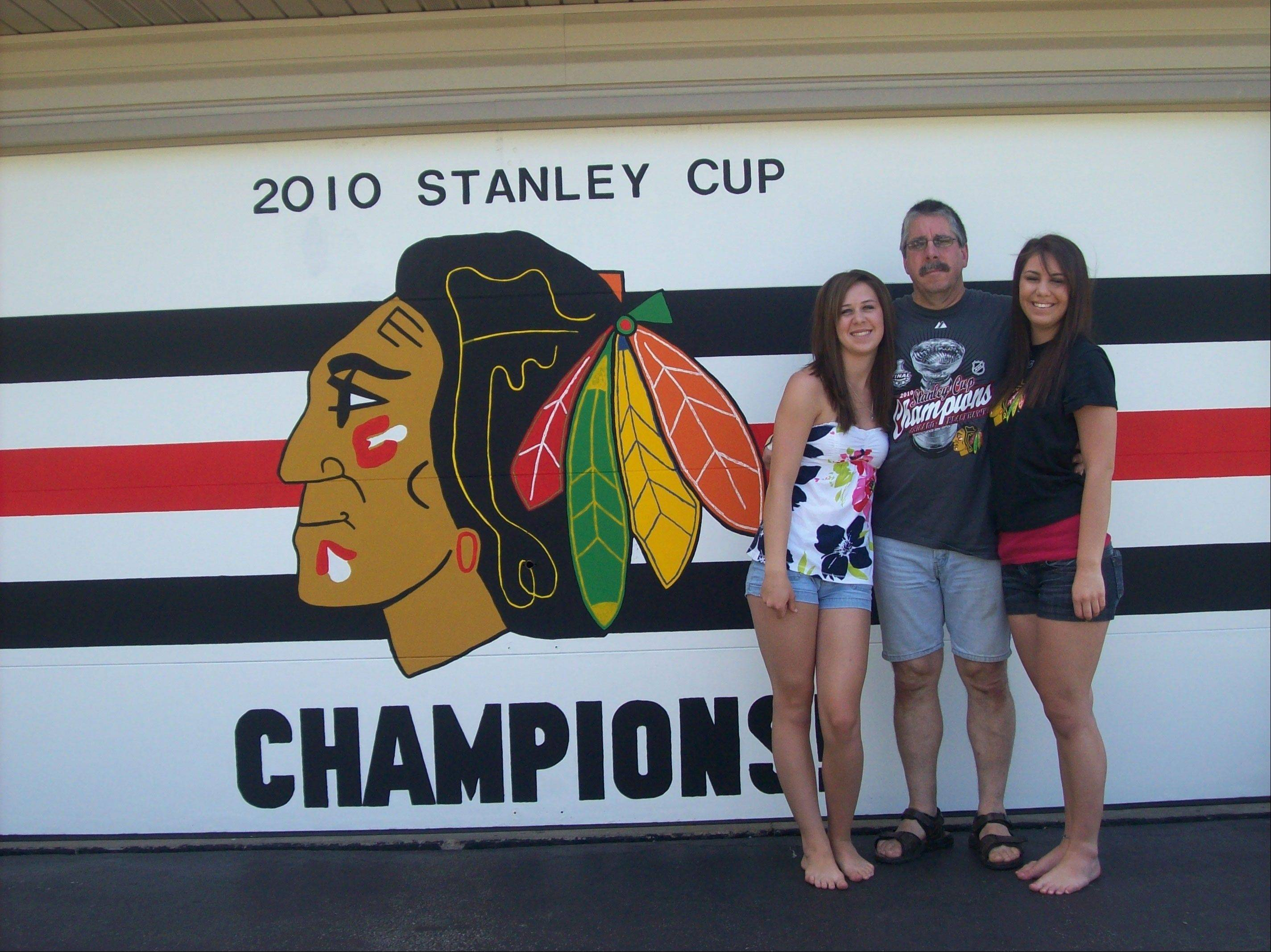 After the Hawks won the Stanley Cup in 2010, the Mahers of Roselle wanted to do something special so Rick and daughters Allison and Christine painted the garage door. They are really looking forward to adding the year 2013, says Mary Maher,