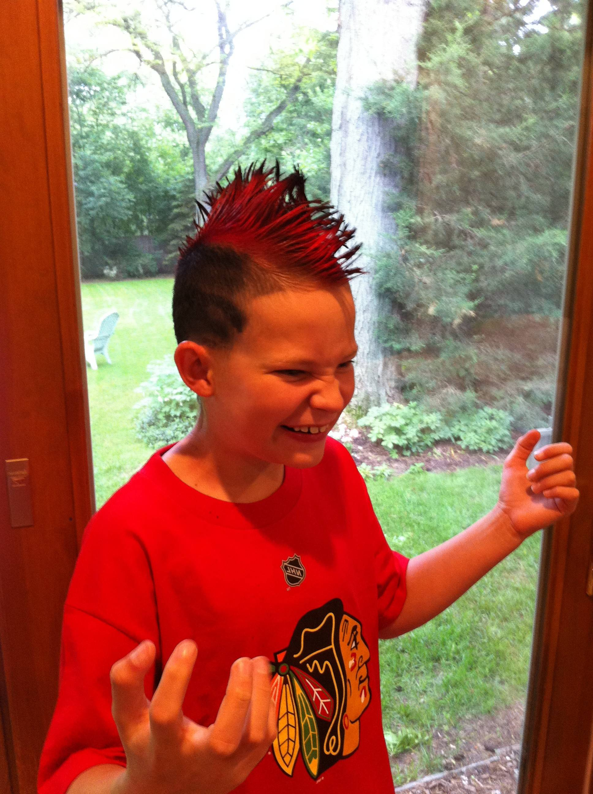 Louie Nielsen, 10, prepares for Blackhawks Day at band camp in Wheaton.